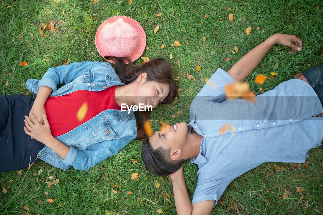 Smiling couple lying on field