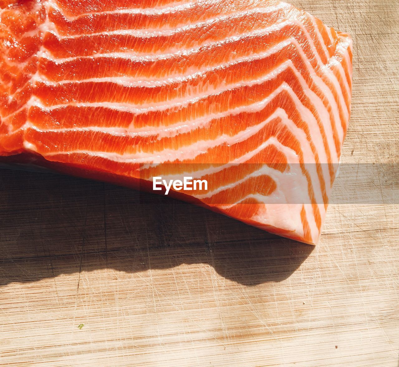 food and drink, food, freshness, indoors, no people, high angle view, close-up, table, meat, preparation, raw food, healthy eating, wellbeing, wood - material, still life, nature, shadow, slice, heat - temperature, single object, japanese food, wood grain