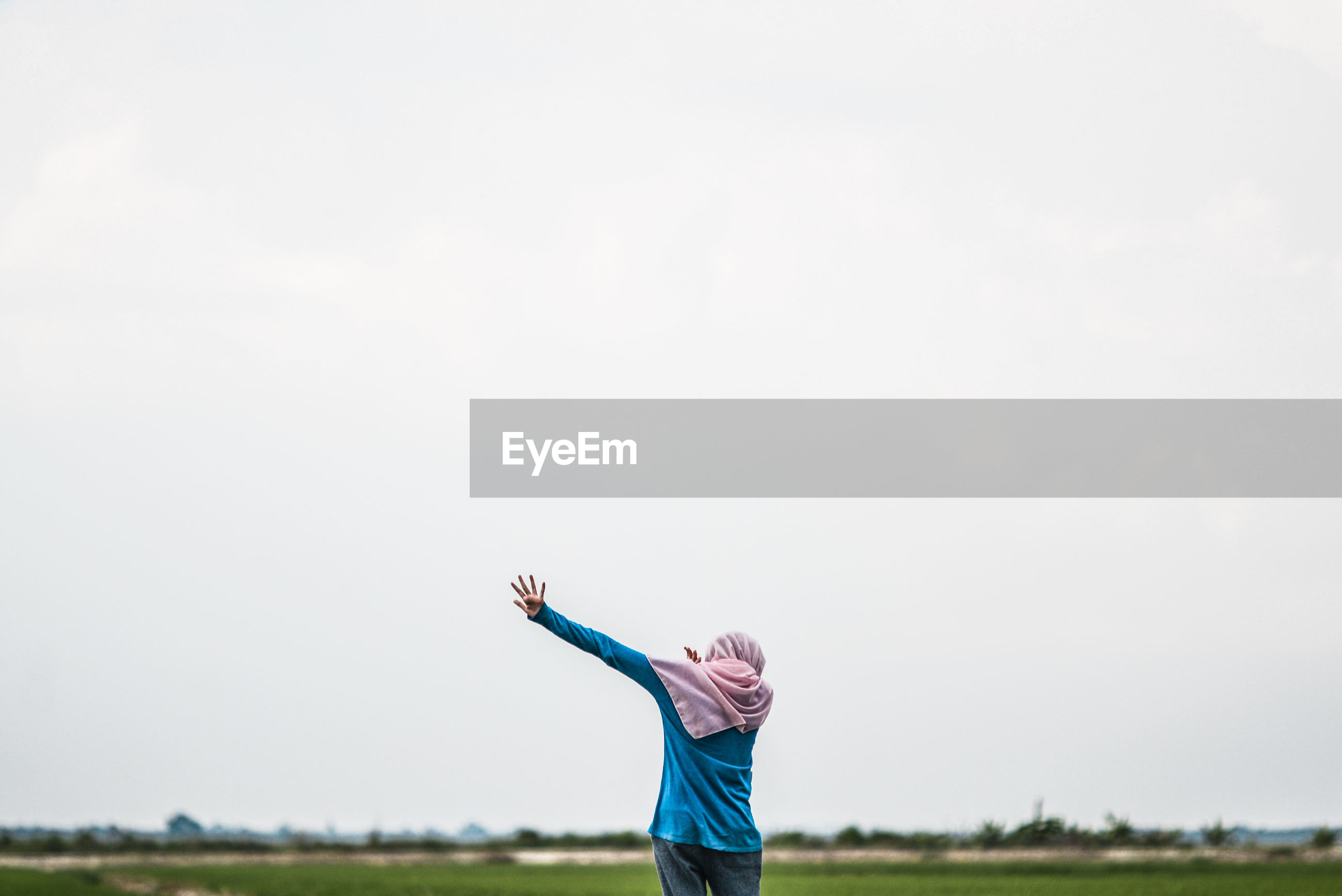 Person on field against clear sky