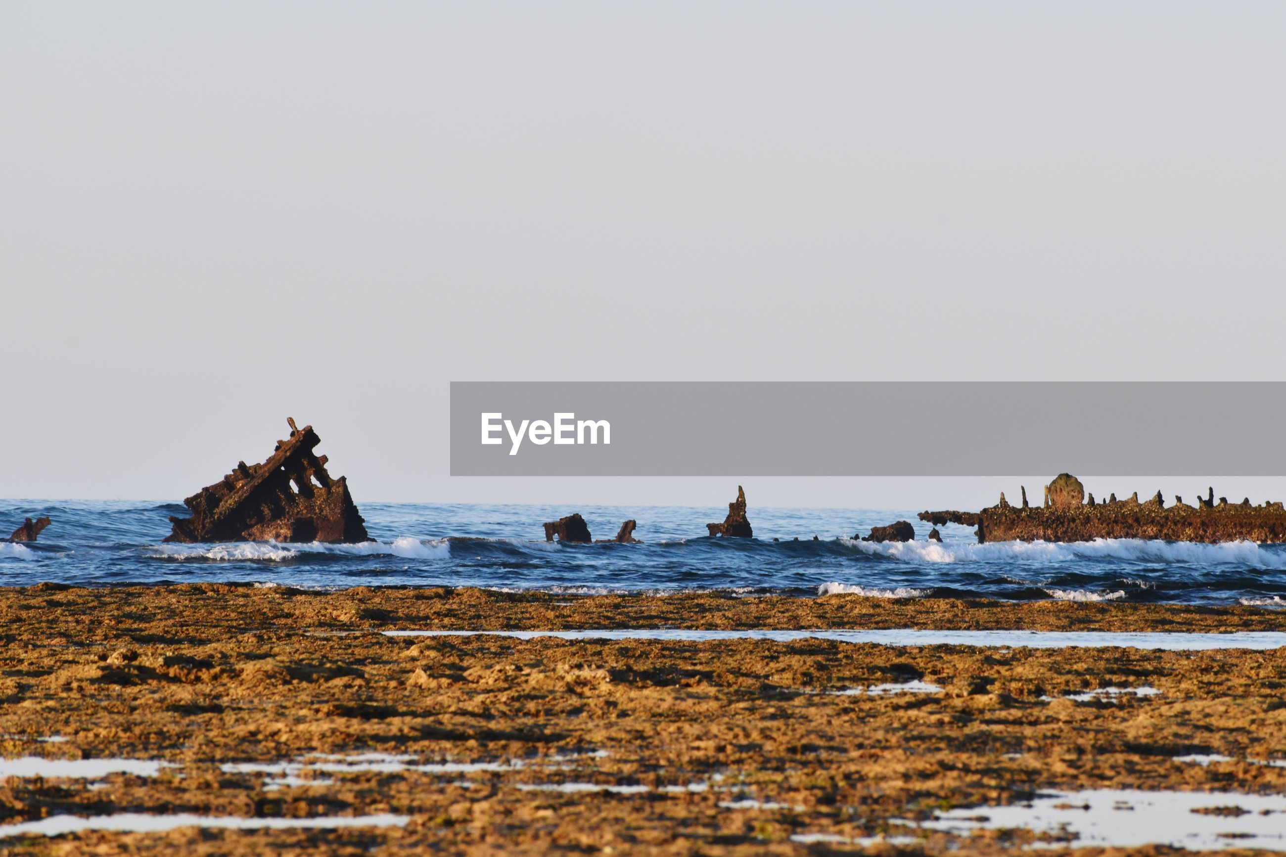 Scenic view of ship wreck against clear sky