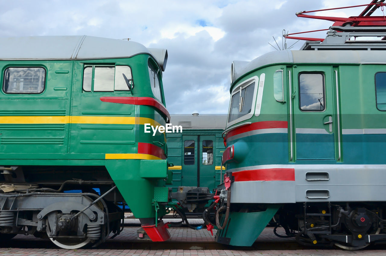 Trains at railroad station against sky