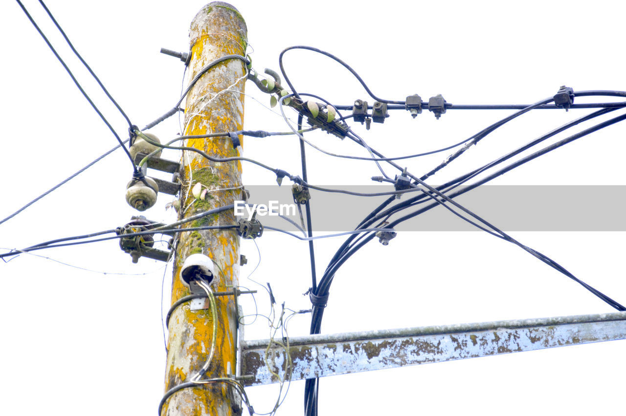 low angle view, cable, clear sky, connection, power line, power supply, electricity, day, no people, outdoors, technology, complexity, close-up, sky, nature
