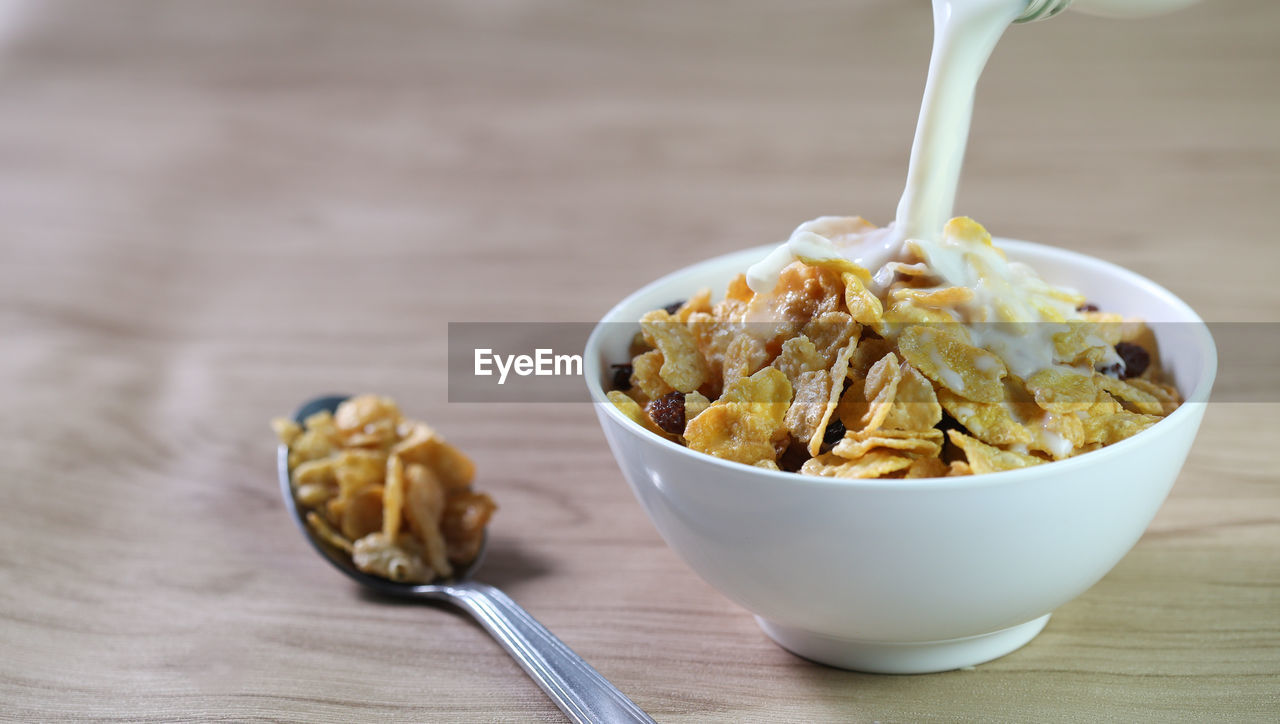 food and drink, eating utensil, kitchen utensil, bowl, food, table, spoon, freshness, still life, close-up, indoors, wood - material, focus on foreground, ready-to-eat, wellbeing, healthy eating, no people, drink, dairy product, breakfast, temptation, snack