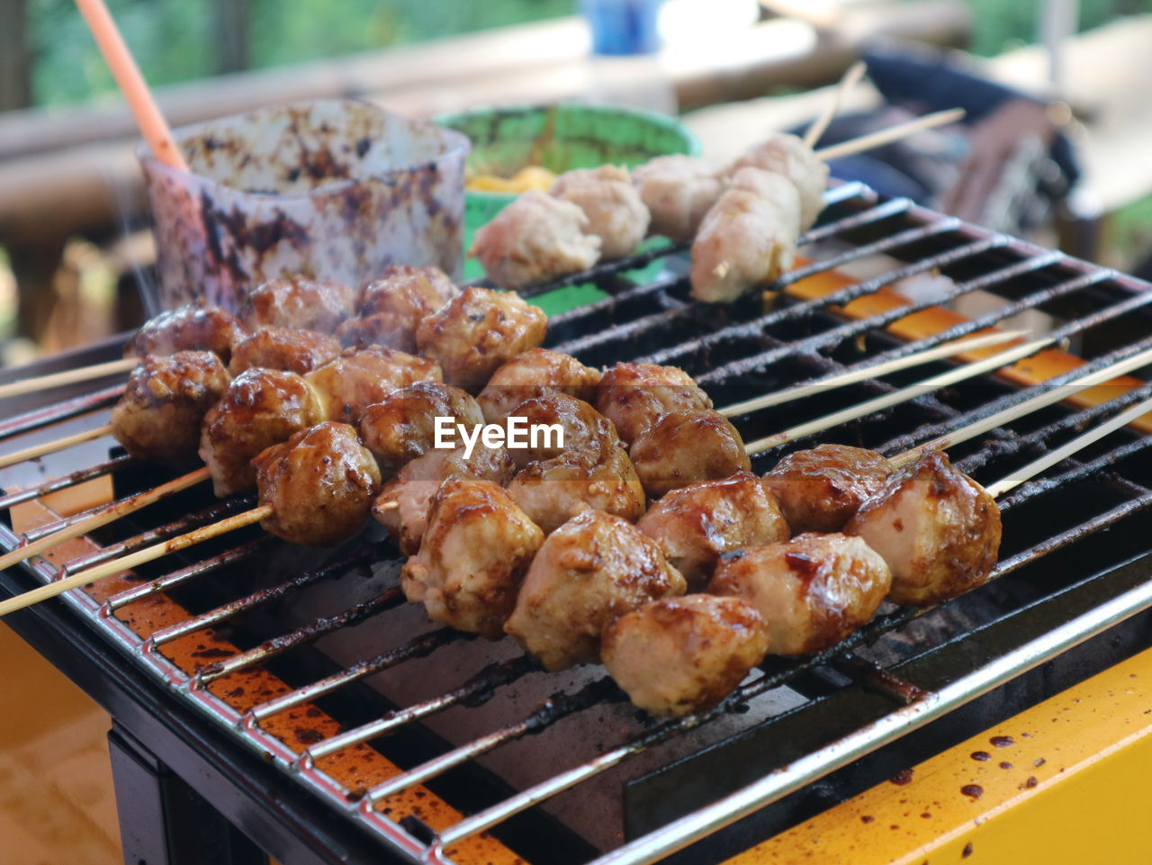CLOSE-UP OF SEAFOOD ON BARBECUE GRILL