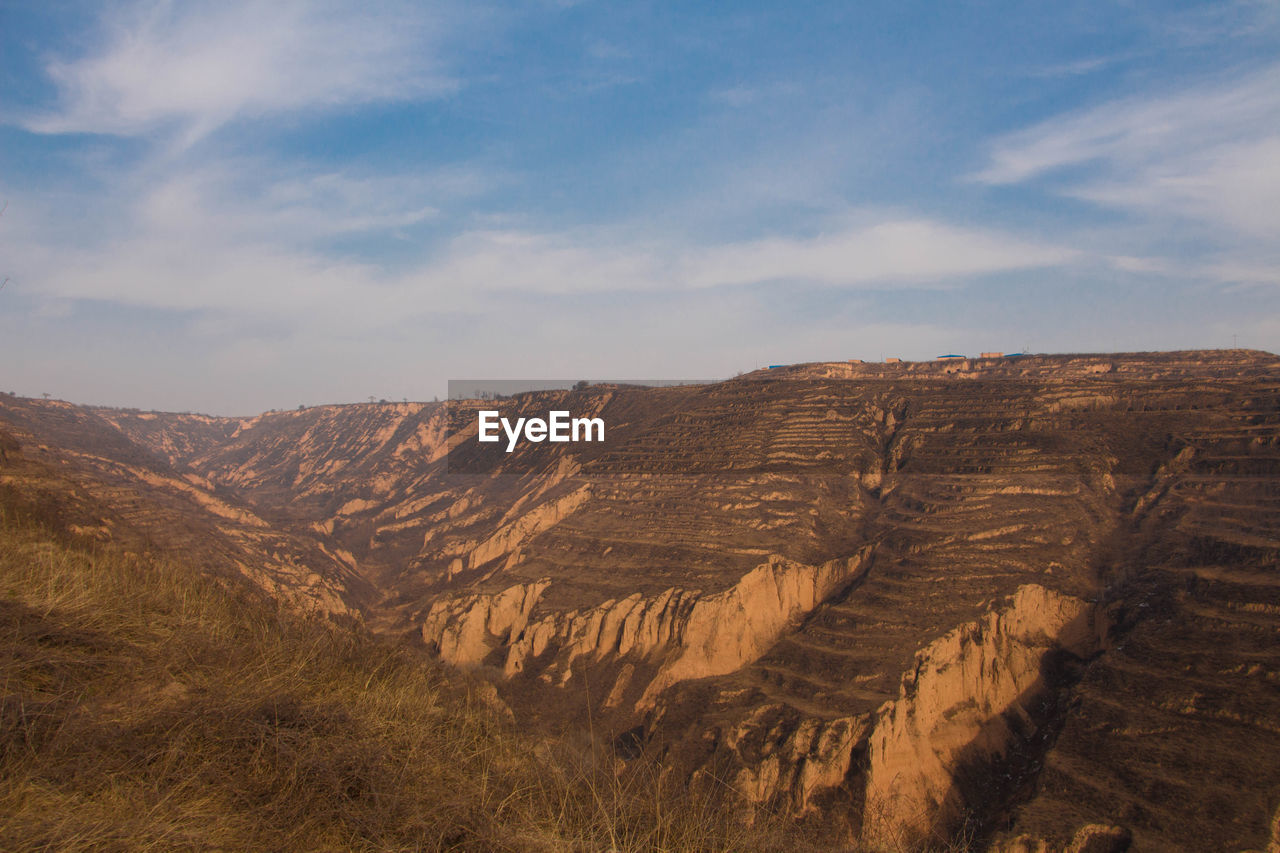 Scenic view of loess plateau against sky