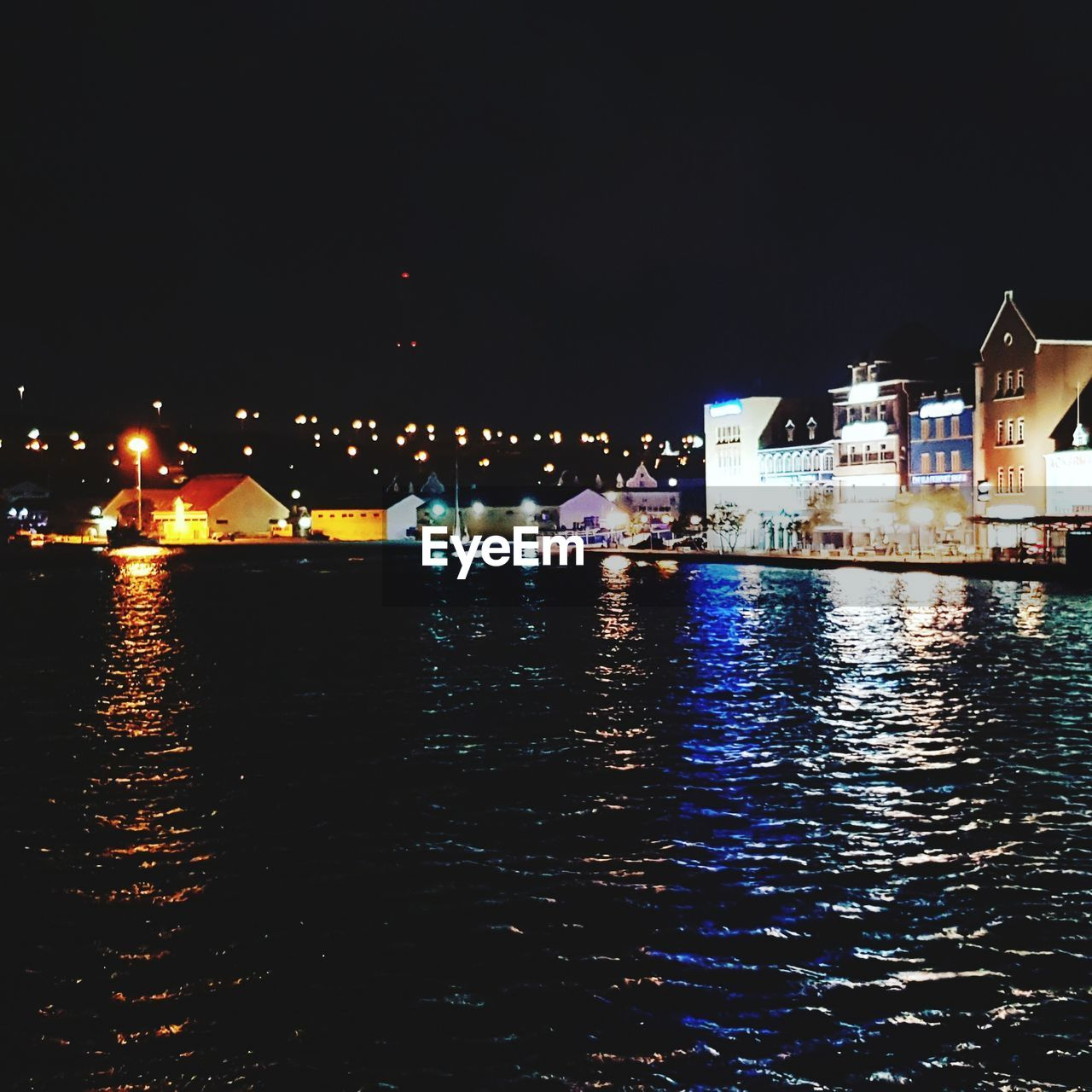 illuminated, night, water, waterfront, architecture, built structure, building exterior, reflection, sky, city, no people, river, nature, copy space, building, nautical vessel, outdoors, clear sky, passenger craft, nightlife