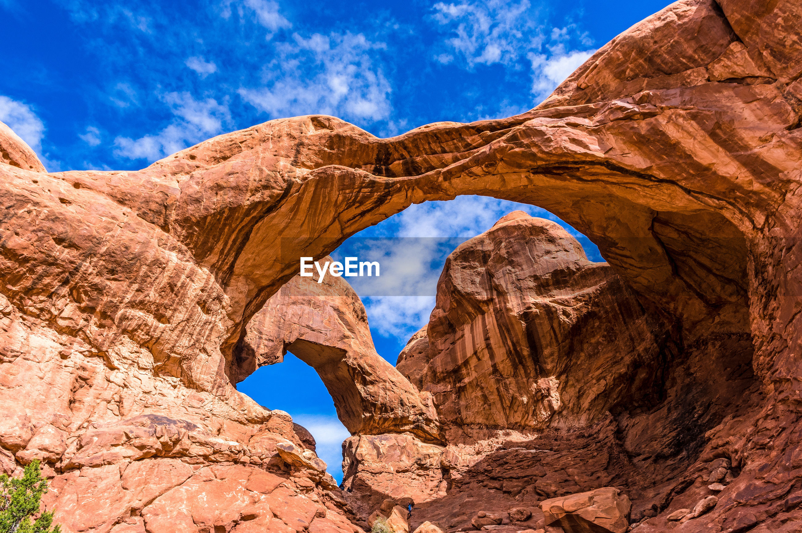 Low angle view of rock formation in desert against blue sky