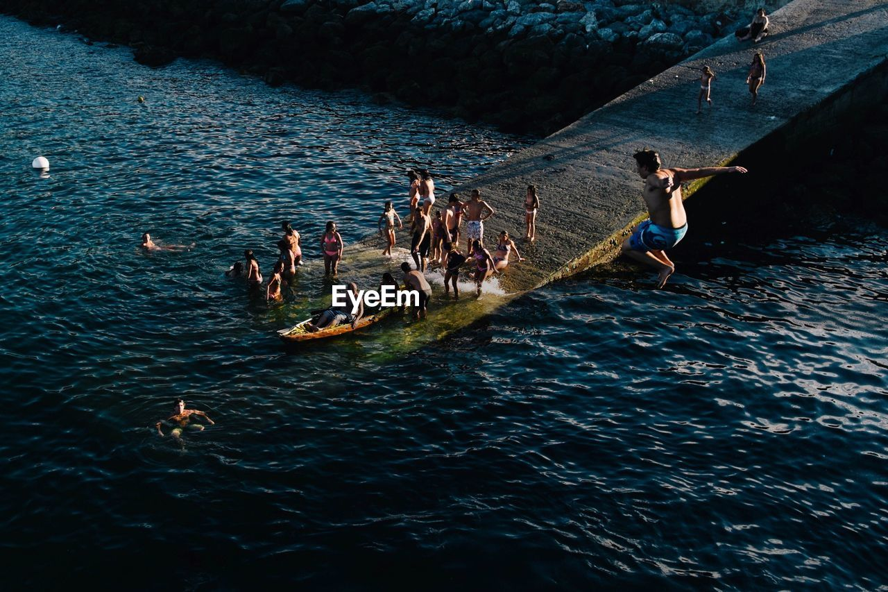High angle view of people enjoying in lake