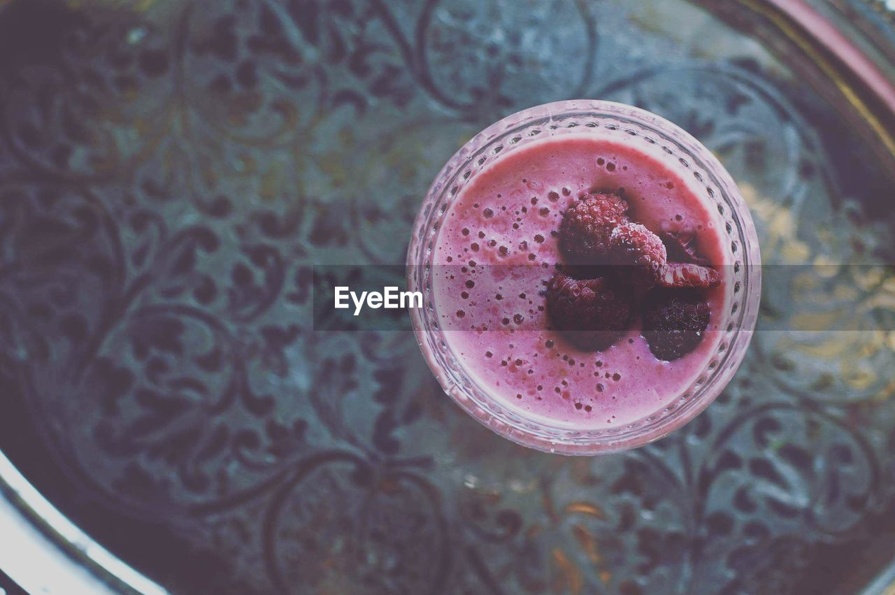 High Angle View Of Raspberry Smoothie On Table