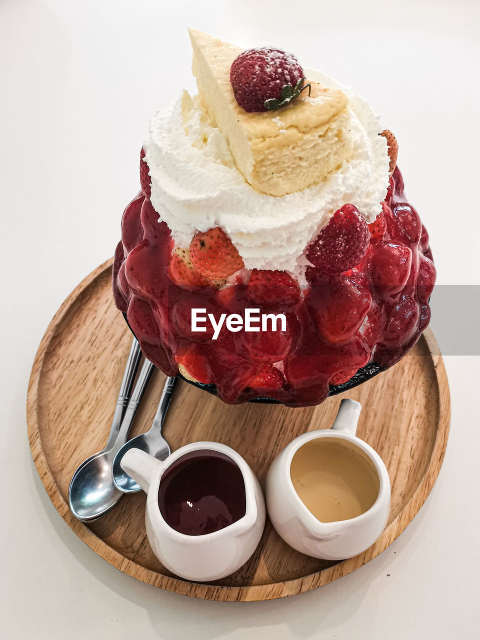 HIGH ANGLE VIEW OF ICE CREAM WITH DESSERT ON TABLE