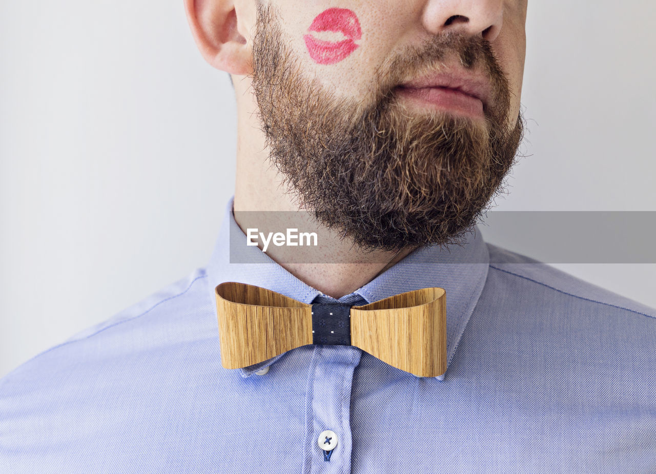 Midsection Of Man With Lipstick Kiss On Cheek