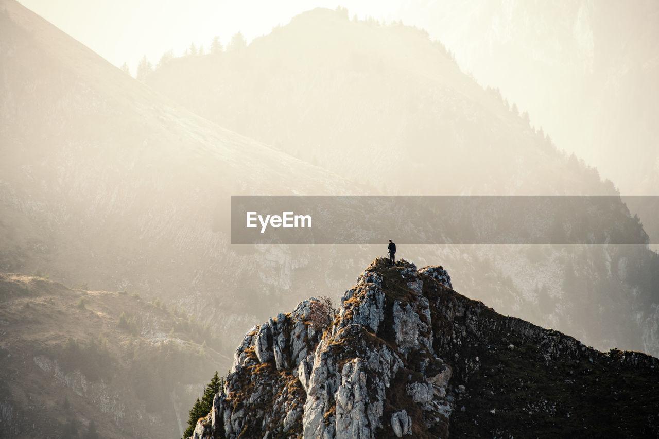 Hiker on top of mountain peak