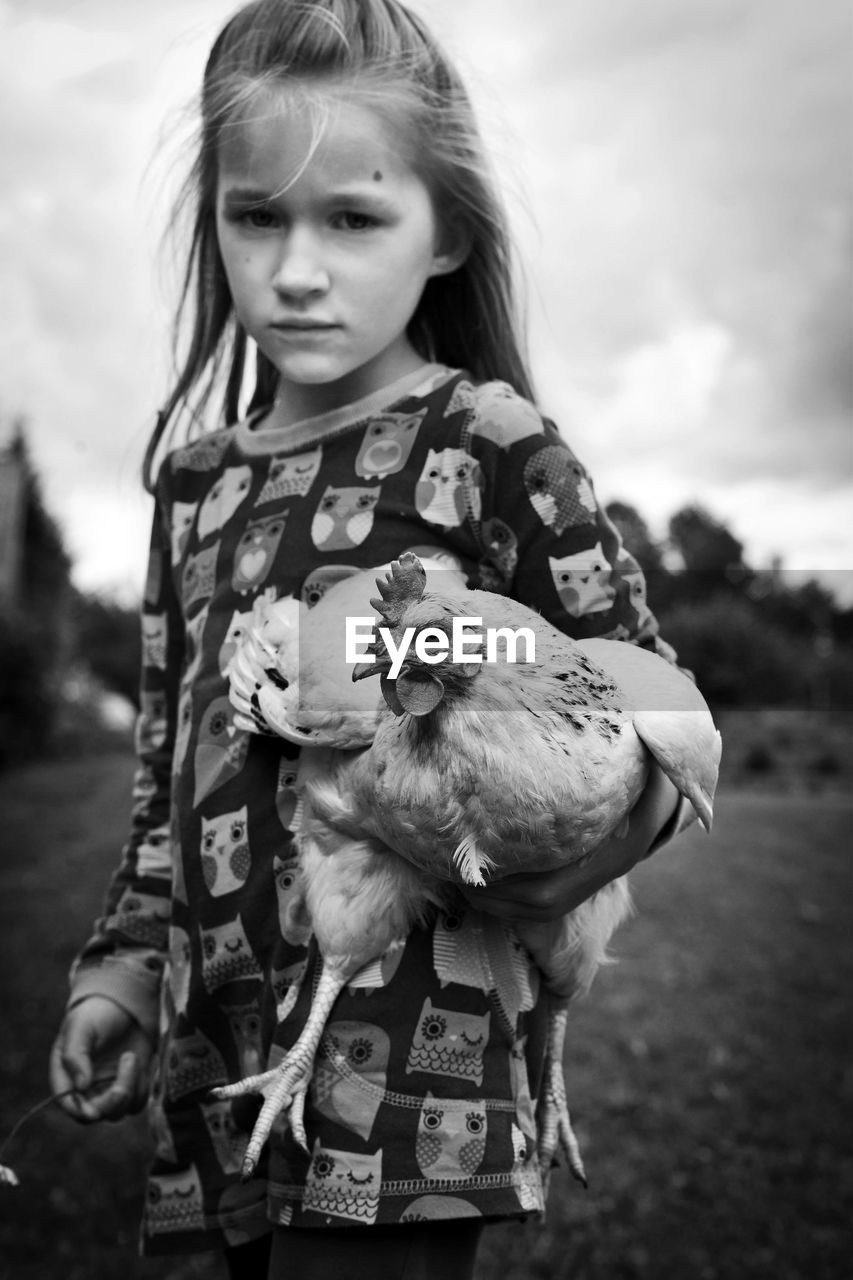 Portrait Of Girl Holding Chicken