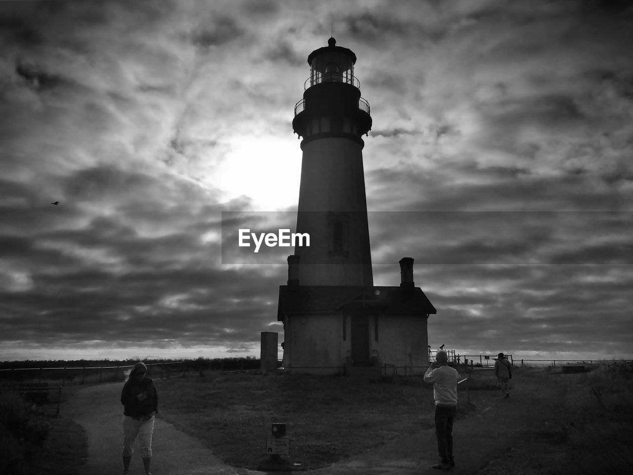 cloud - sky, sky, real people, outdoors, lighthouse, men, nature, sea, architecture, day, people
