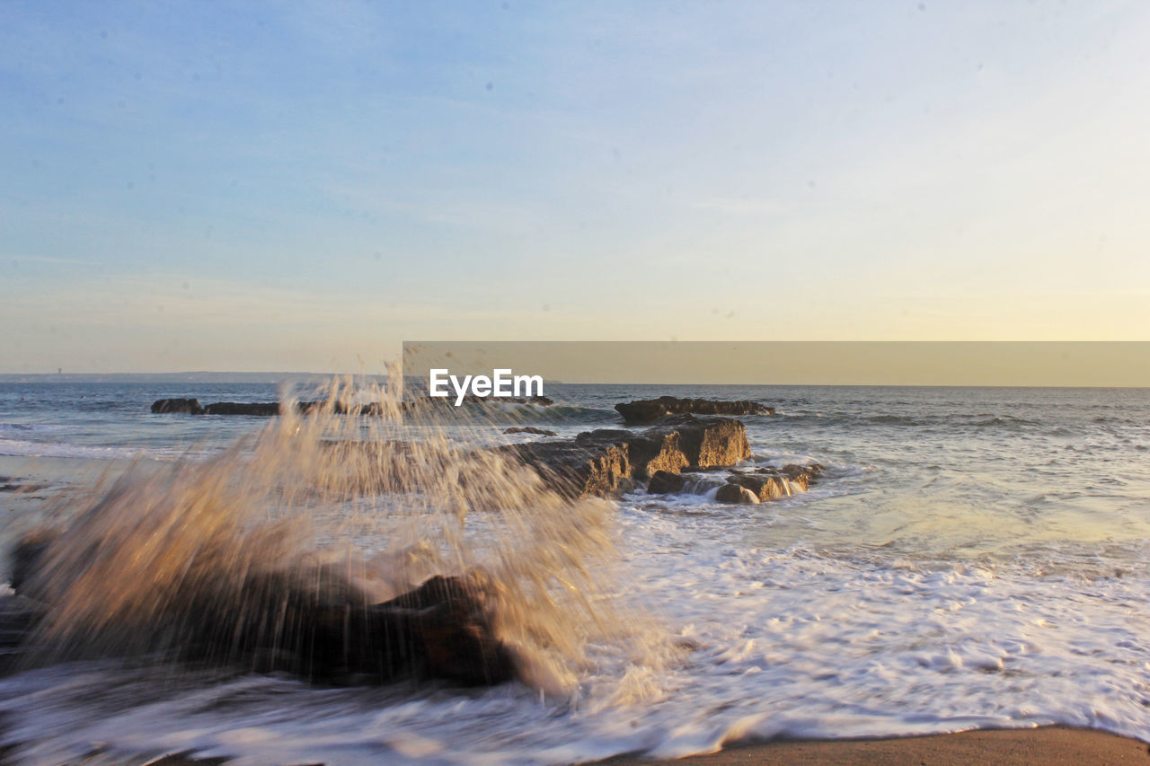 sea, water, horizon over water, horizon, sky, beauty in nature, motion, scenics - nature, beach, nature, sunset, land, no people, wave, sport, idyllic, tranquility, splashing, tranquil scene