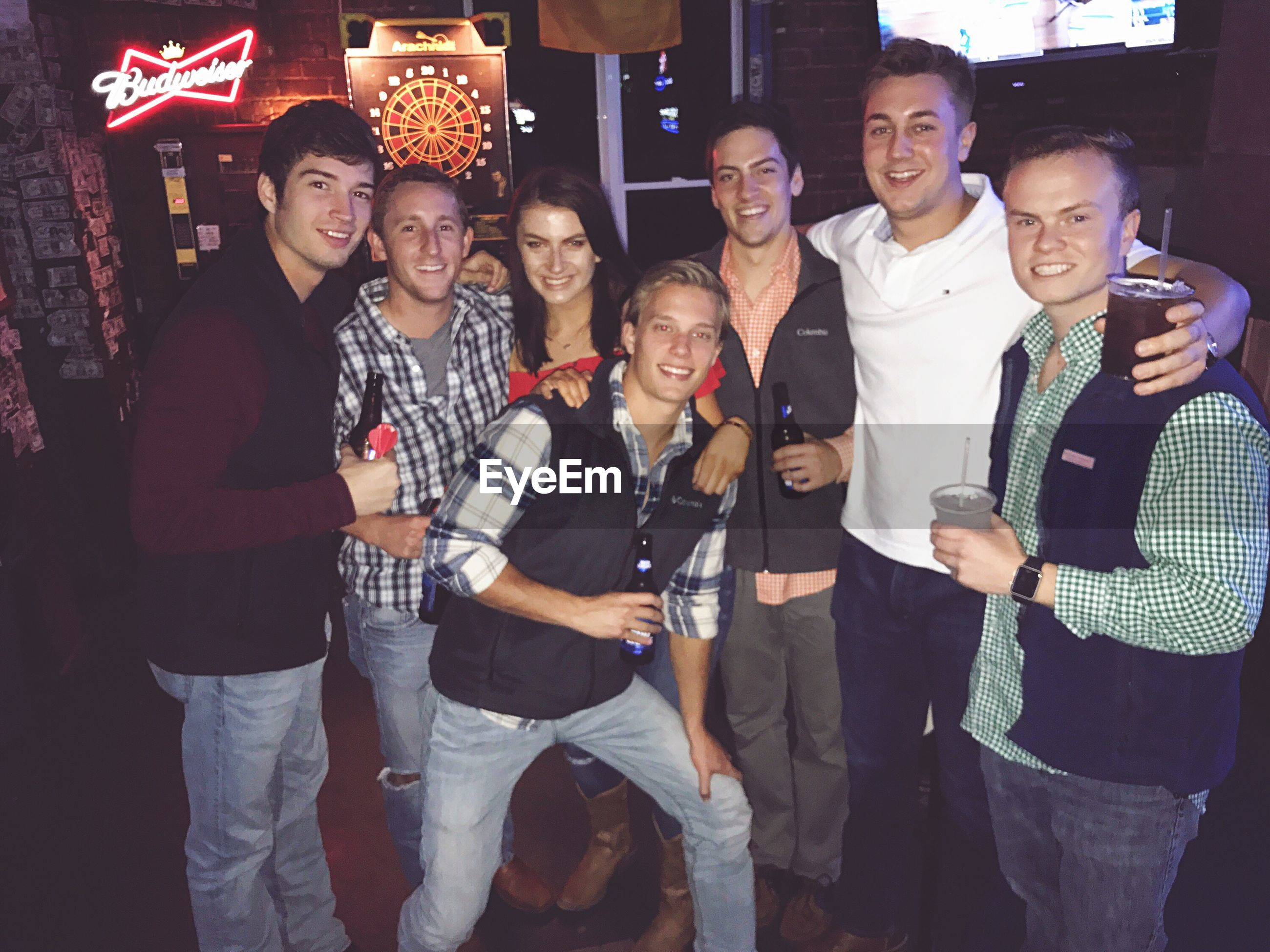 night, smiling, togetherness, enjoyment, young men, celebration, friendship, young adult, nightlife, standing, men, leisure activity, happiness, illuminated, lifestyles, young women, portrait, nightclub, party - social event, outdoors, adult, people