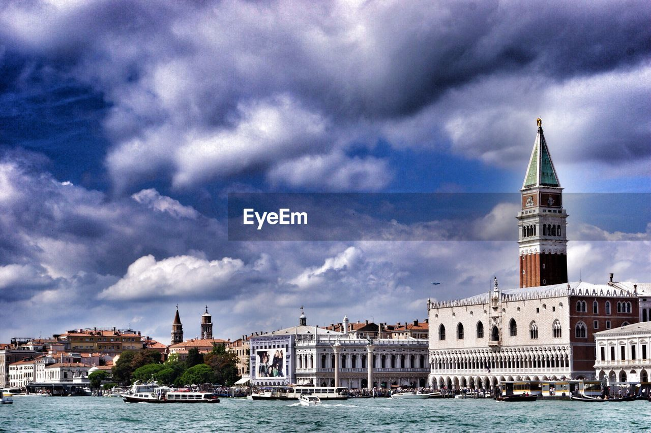 architecture, cloud - sky, water, built structure, building exterior, sky, nautical vessel, waterfront, tower, place of worship, religion, transportation, history, mode of transport, spirituality, day, outdoors, travel destinations, no people, city