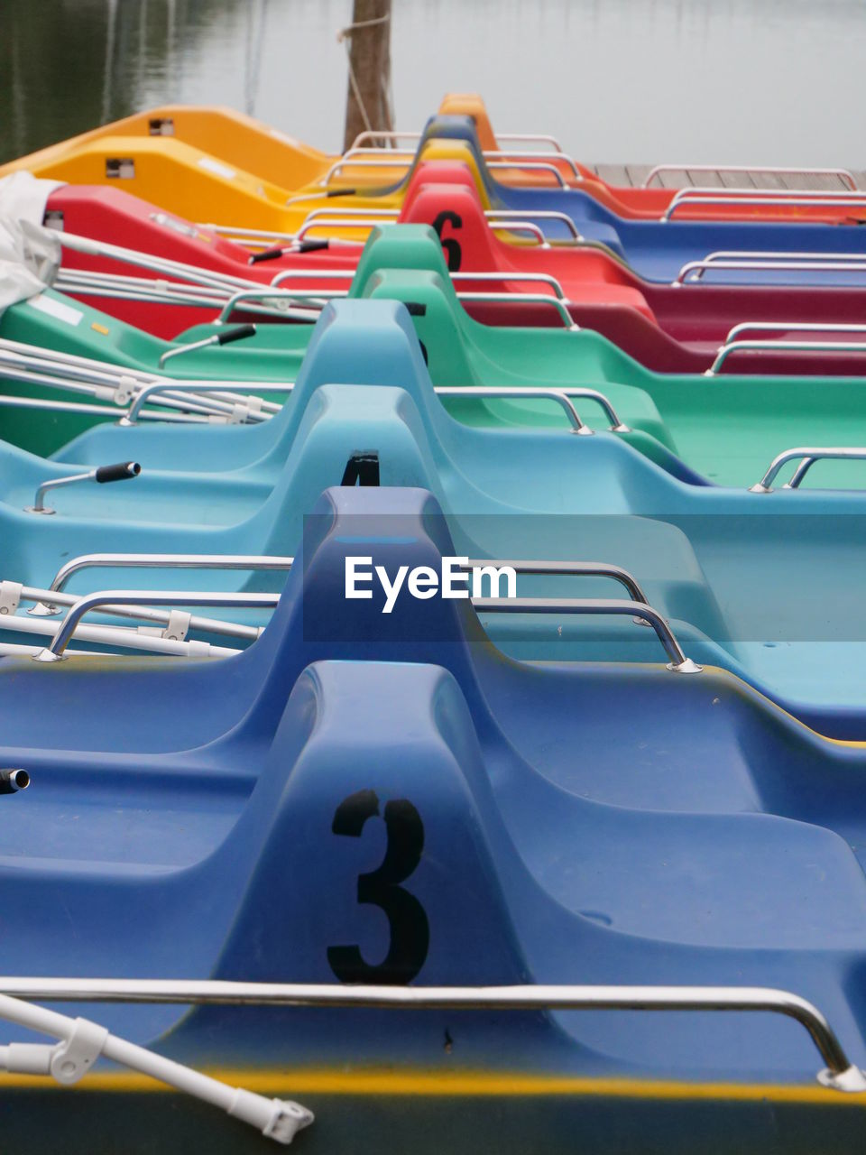 Multi colored boats moored in lake