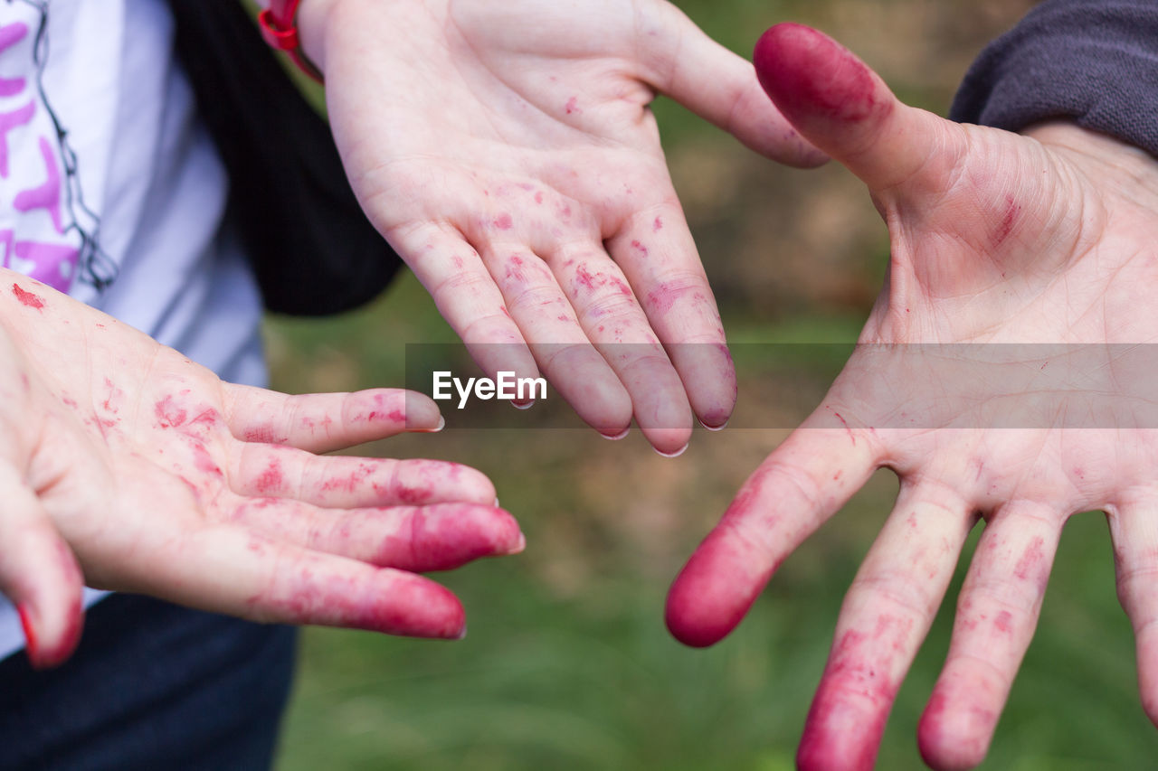 Cropped Image Of Hands With Painted Fingers