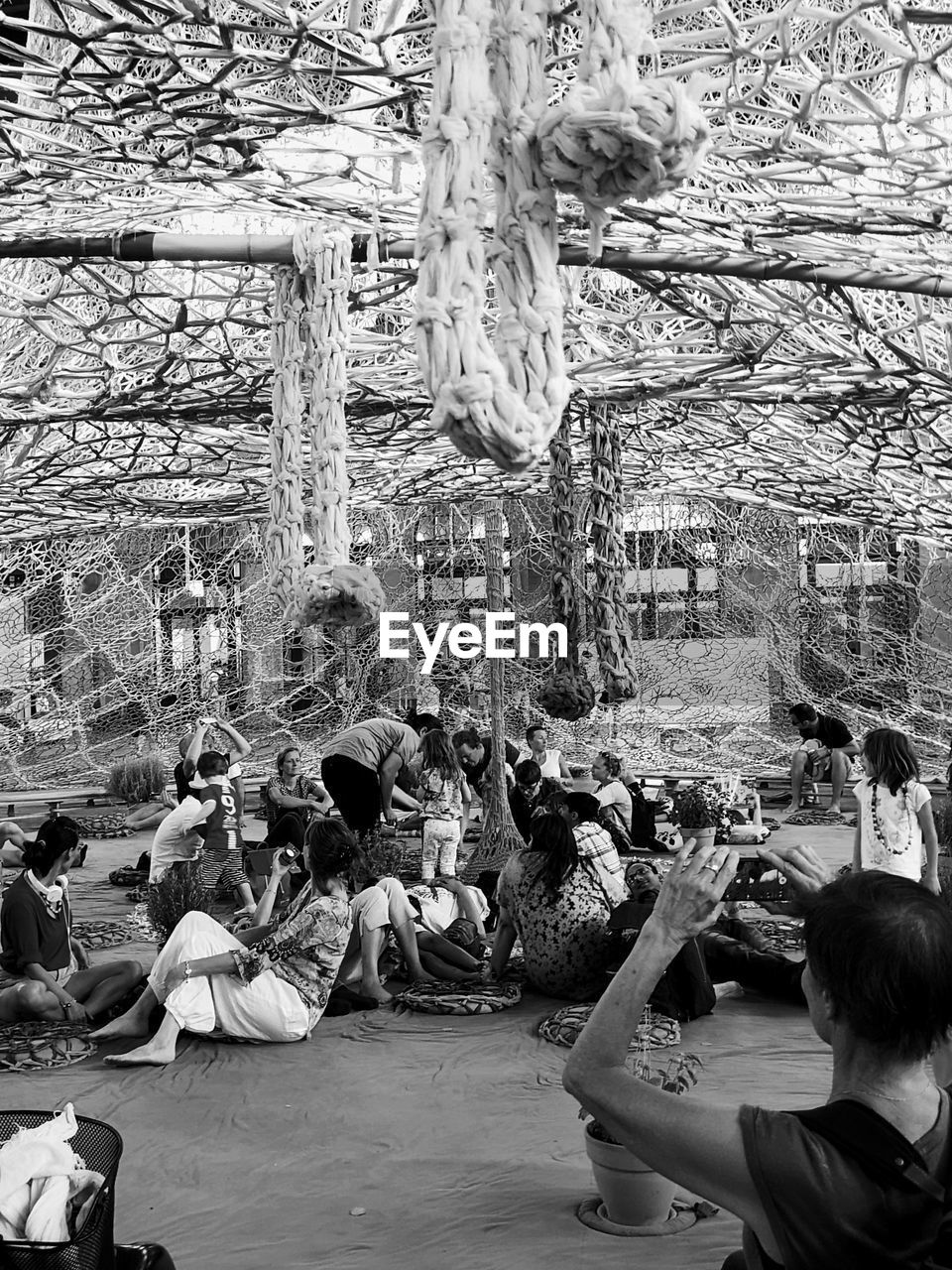 crowd, group of people, large group of people, real people, women, men, lifestyles, leisure activity, adult, day, enjoyment, architecture, built structure, tree, outdoors, fun, celebration, human arm, arms raised, festival