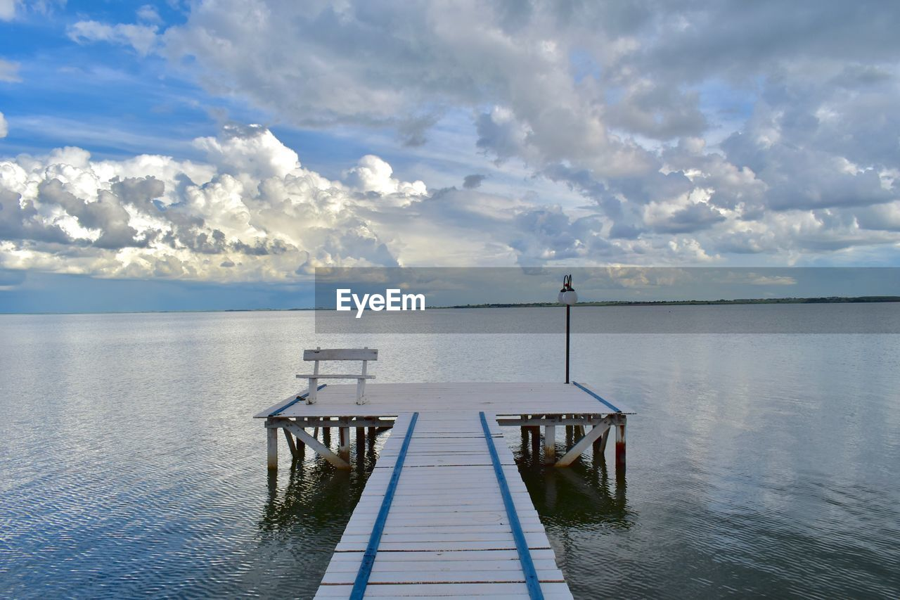 cloud - sky, sky, water, tranquil scene, beauty in nature, tranquility, scenics - nature, sea, pier, nature, horizon, no people, day, horizon over water, idyllic, empty, railing, outdoors, reflection