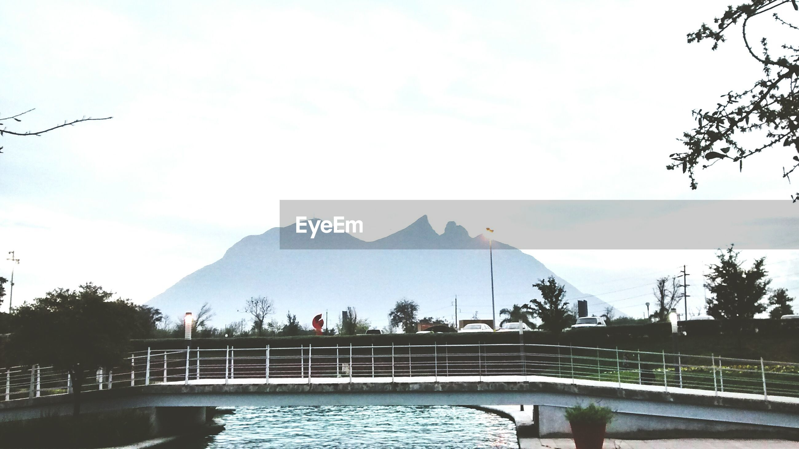water, railing, mountain, sky, river, tree, cloud - sky, mountain range, built structure, bridge - man made structure, nature, tranquility, cloud, beauty in nature, tranquil scene, lake, scenics, connection, architecture, waterfront