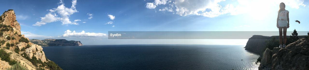 PANORAMIC SHOT OF SEA AND ROCKS AGAINST SKY