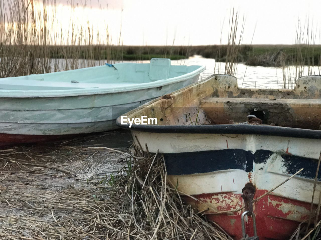 nautical vessel, boat, transportation, moored, abandoned, mode of transport, no people, water, outdoors, day, nature, grass, sky
