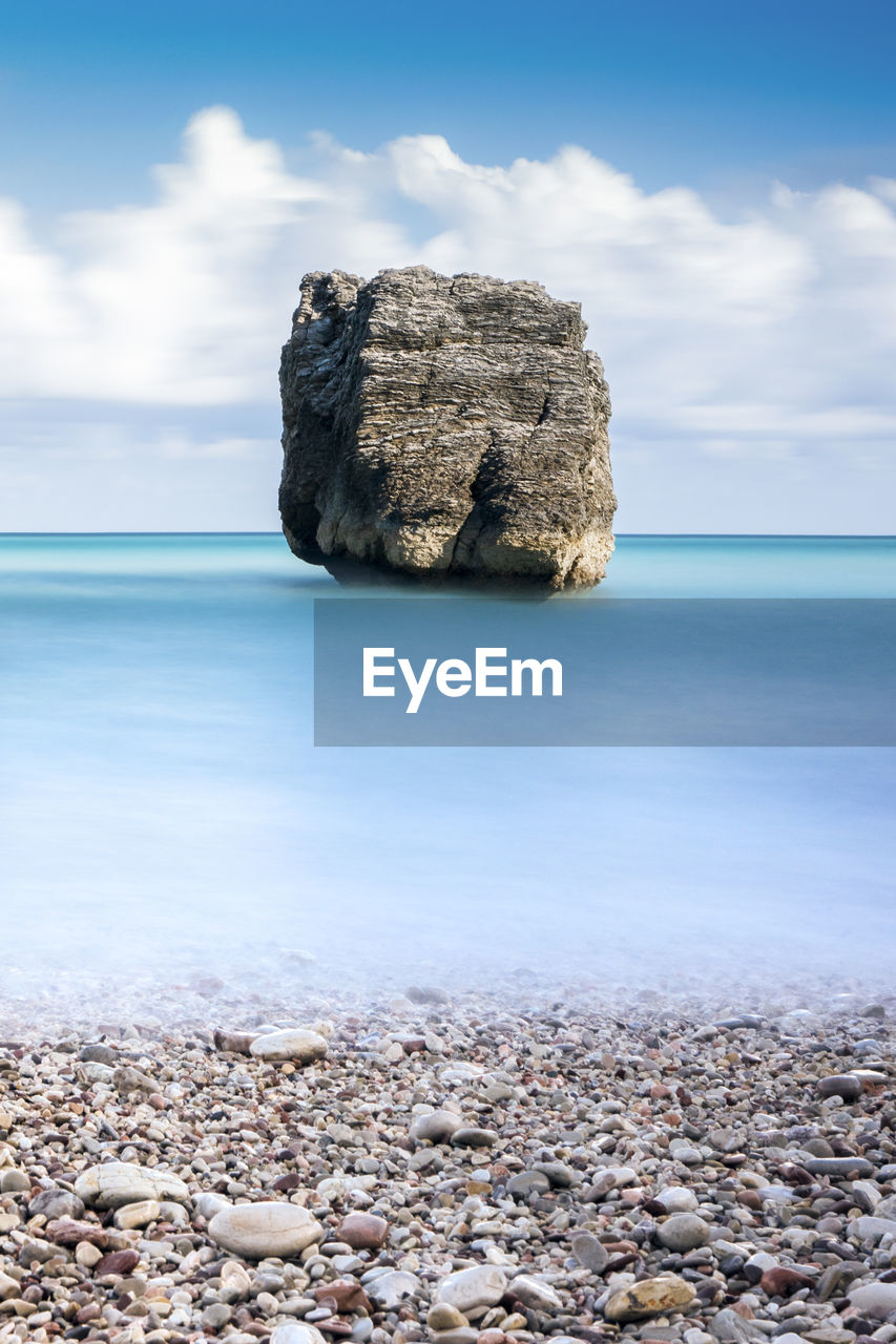 sea, water, sky, rock, solid, scenics - nature, beach, cloud - sky, horizon over water, land, horizon, tranquil scene, beauty in nature, stone, nature, tranquility, rock - object, day, pebble, no people, stone - object, outdoors, stack rock
