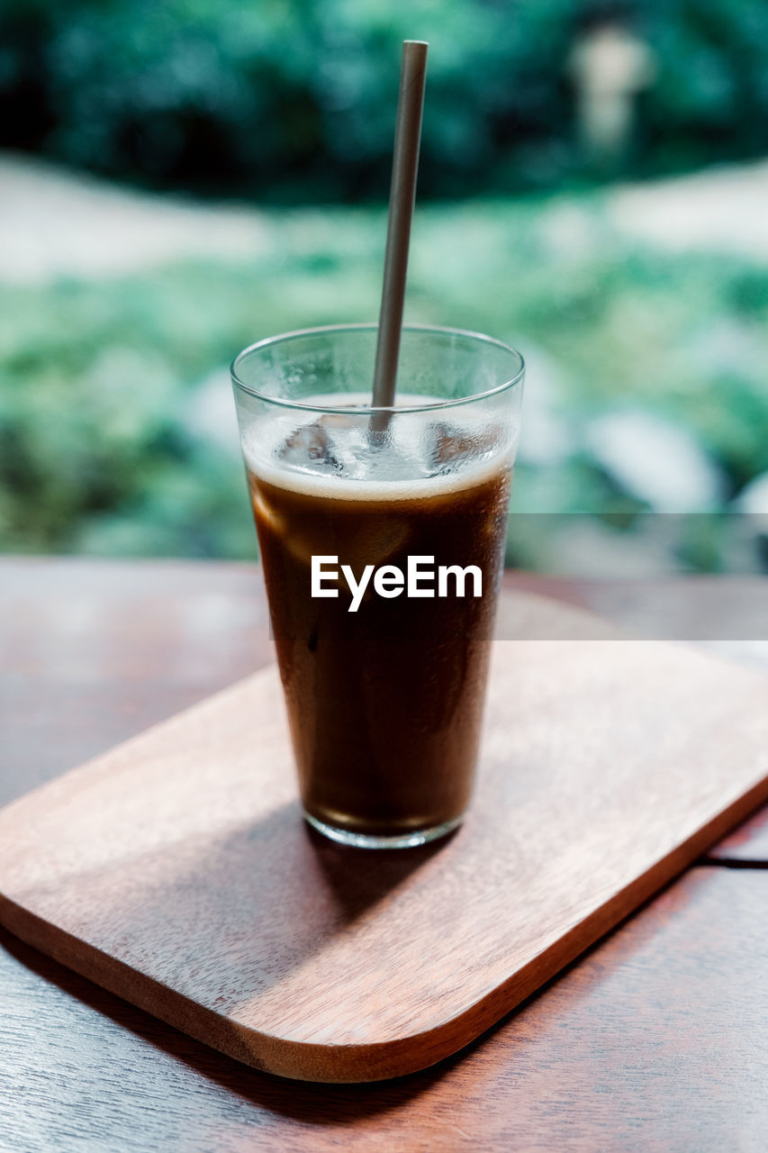 drink, food and drink, refreshment, table, glass, freshness, still life, food, wood - material, drinking glass, household equipment, straw, coffee - drink, coffee, day, close-up, no people, drinking straw, focus on foreground, hot drink, non-alcoholic beverage