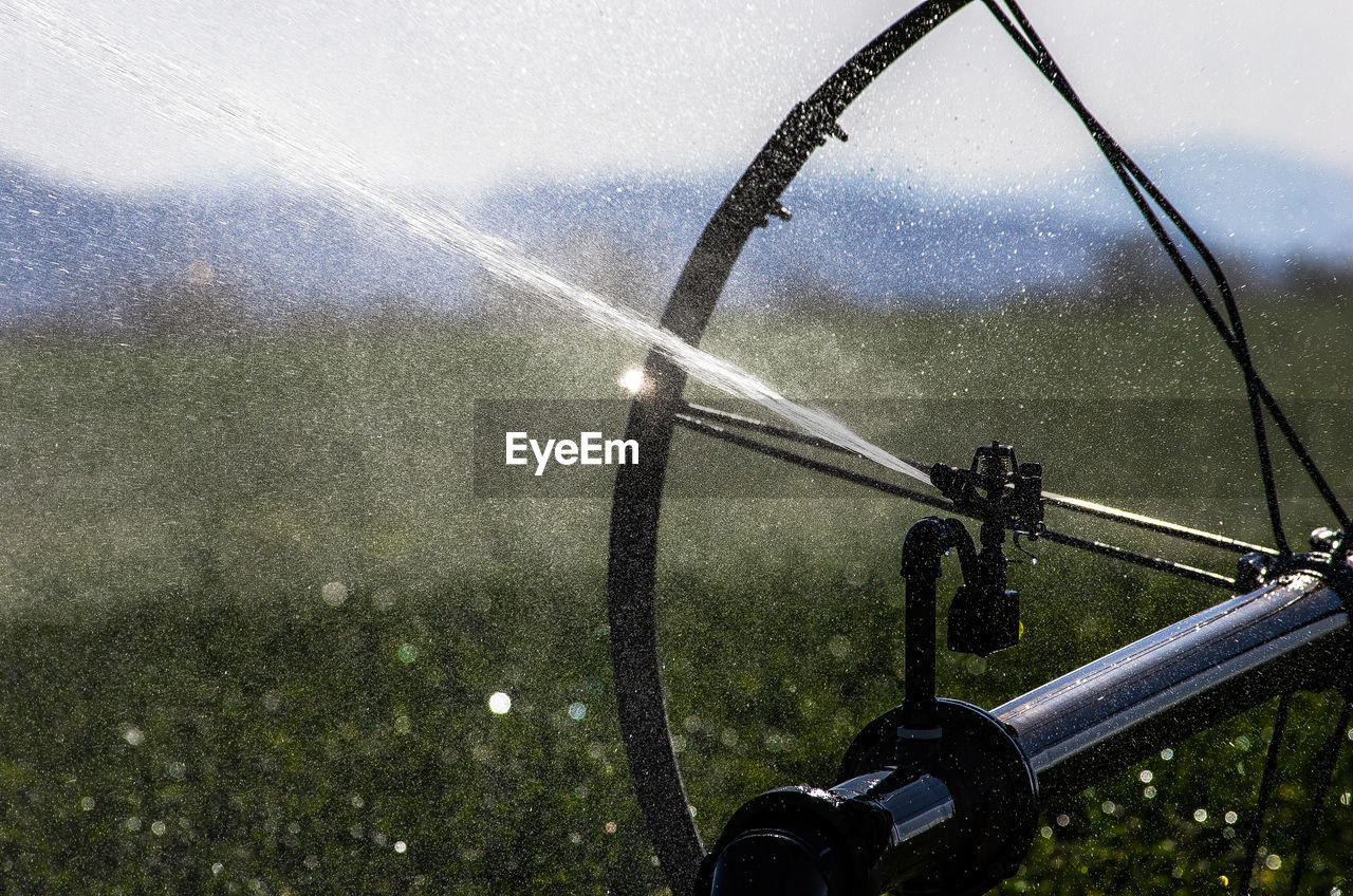 Close-Up Of Agricultural Sprinkler In Field