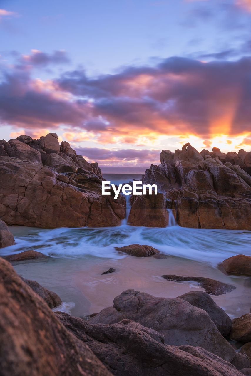 sky, sunset, water, beauty in nature, cloud - sky, scenics - nature, rock, tranquil scene, tranquility, rock - object, solid, idyllic, rock formation, sea, nature, non-urban scene, no people, remote, land, outdoors, iceberg, eroded