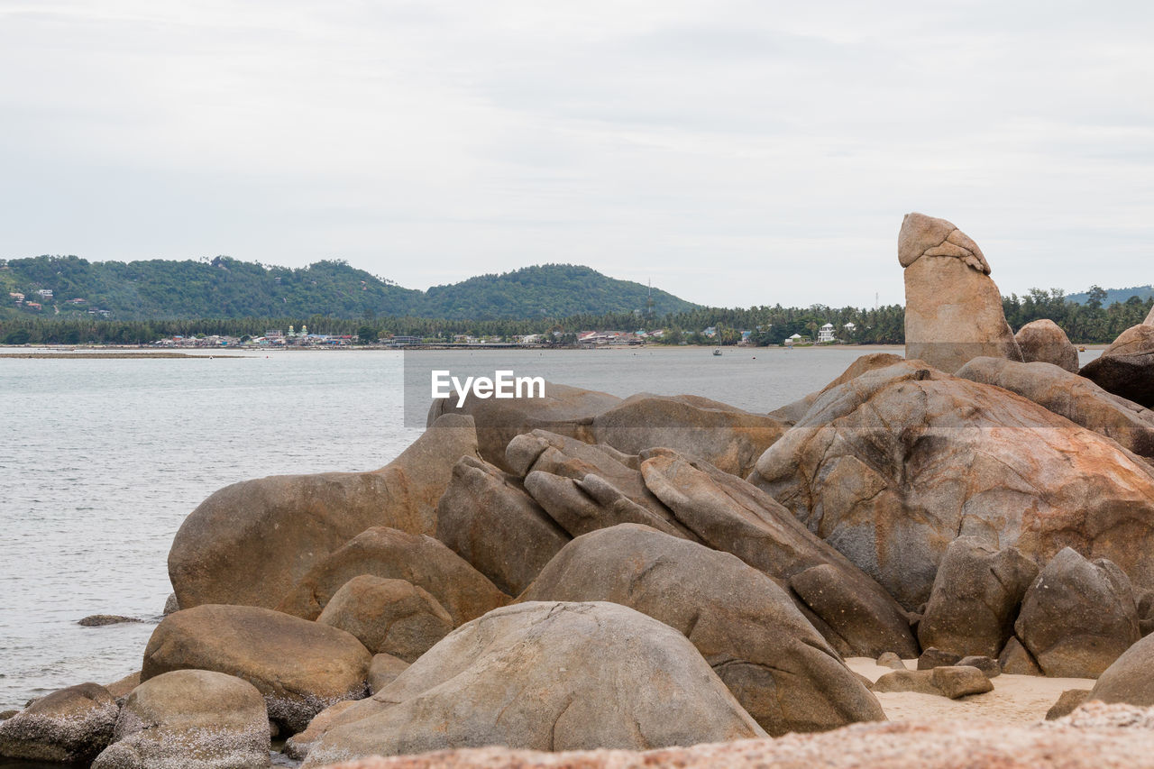 water, sky, solid, rock, nature, scenics - nature, tranquility, day, beauty in nature, tranquil scene, rock - object, no people, cloud - sky, sea, mountain, beach, non-urban scene, land, art and craft