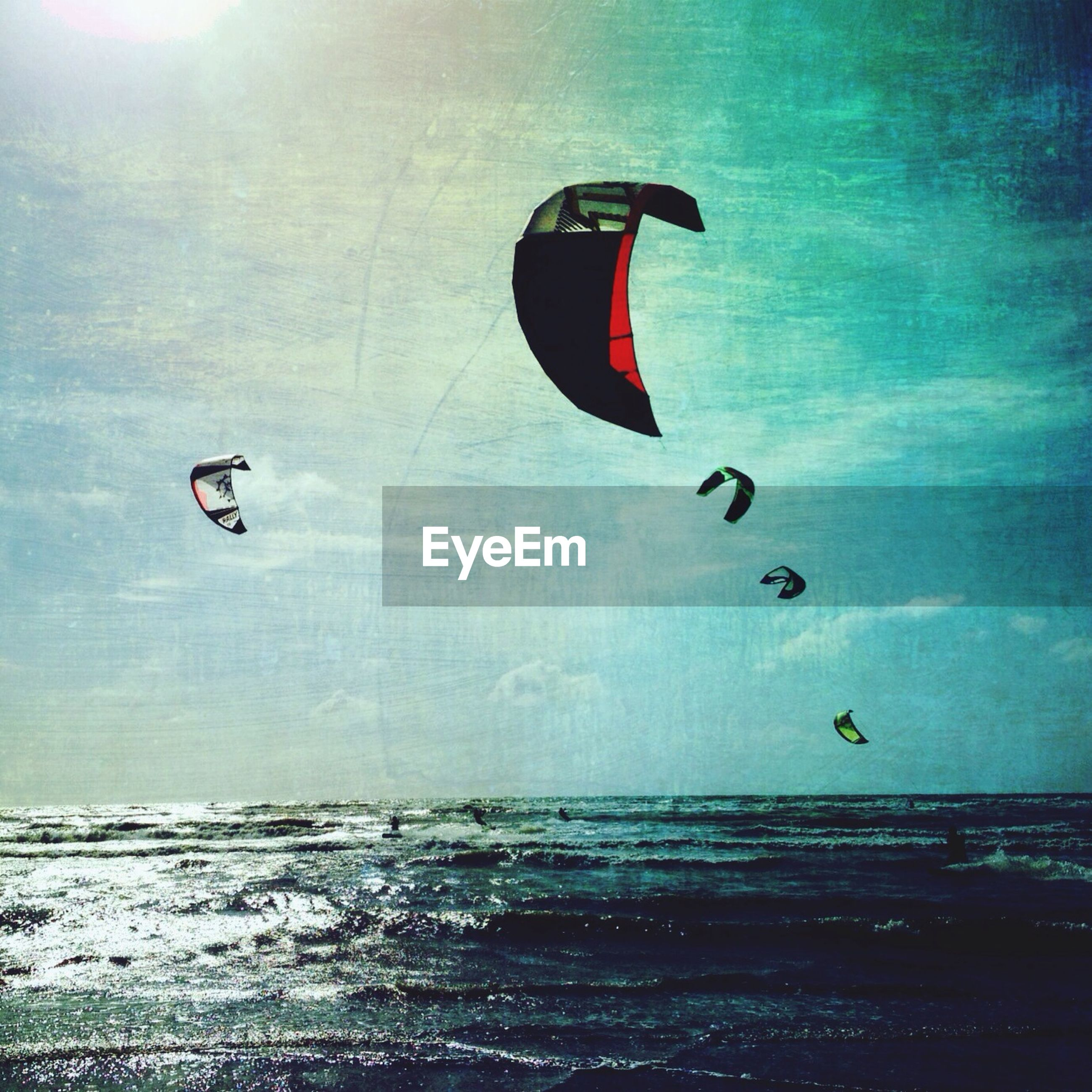 parachute, mid-air, water, sea, adventure, flying, extreme sports, paragliding, sport, waterfront, transportation, horizon over water, leisure activity, tranquility, sky, scenics, exhilaration, parachuting, vacations, one person