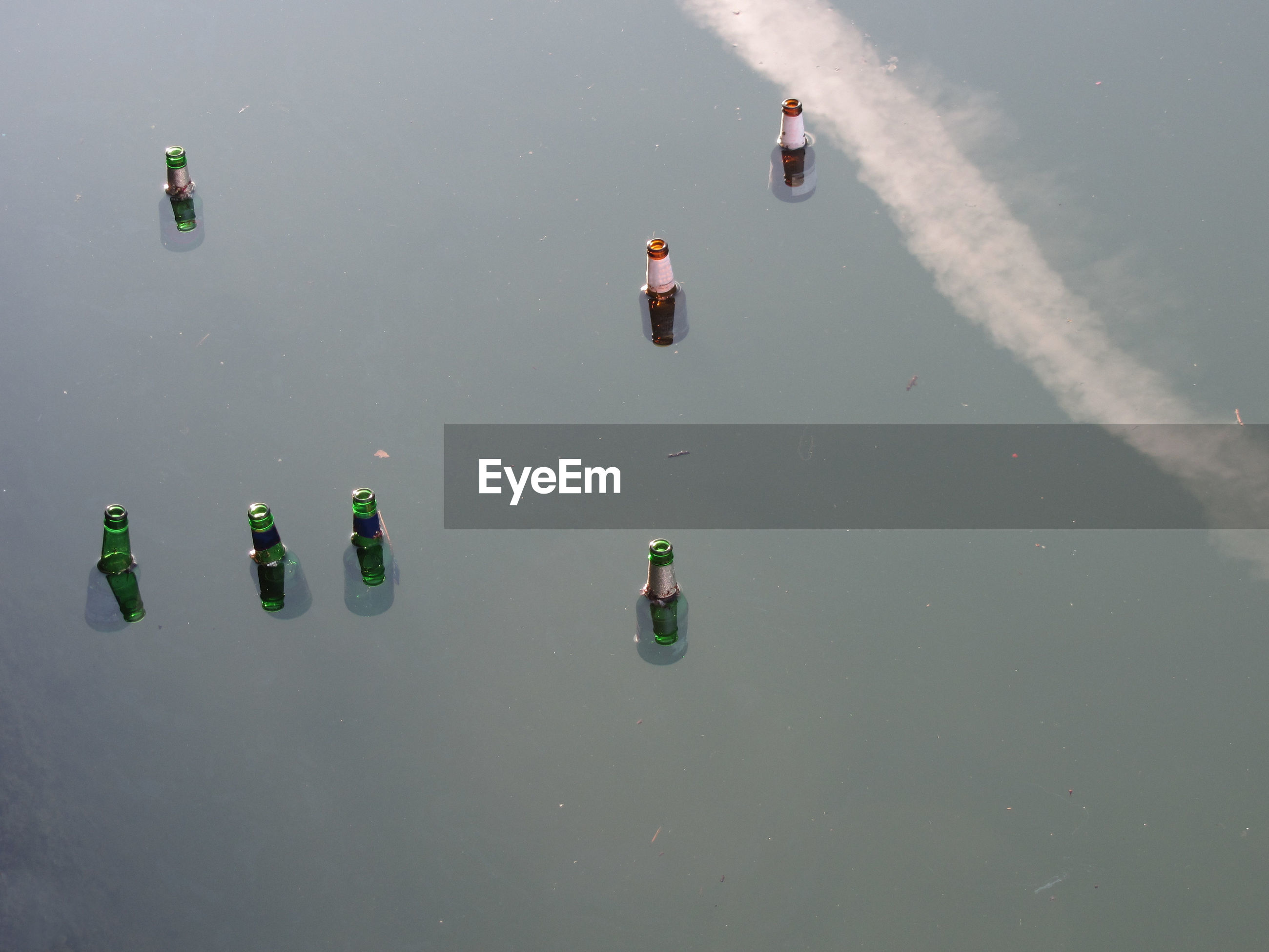 High angle view of bottles floating on water
