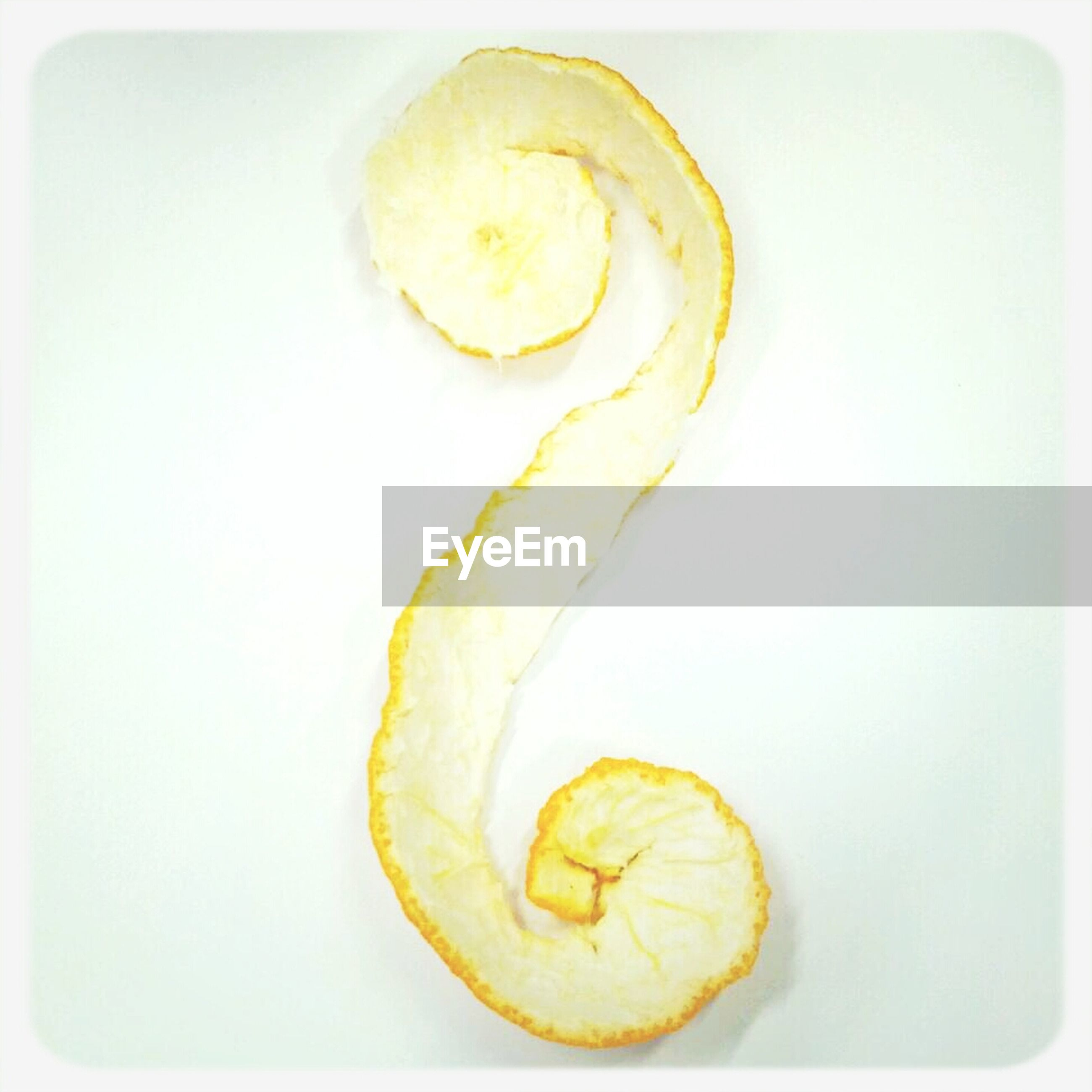 Orange peel over white background