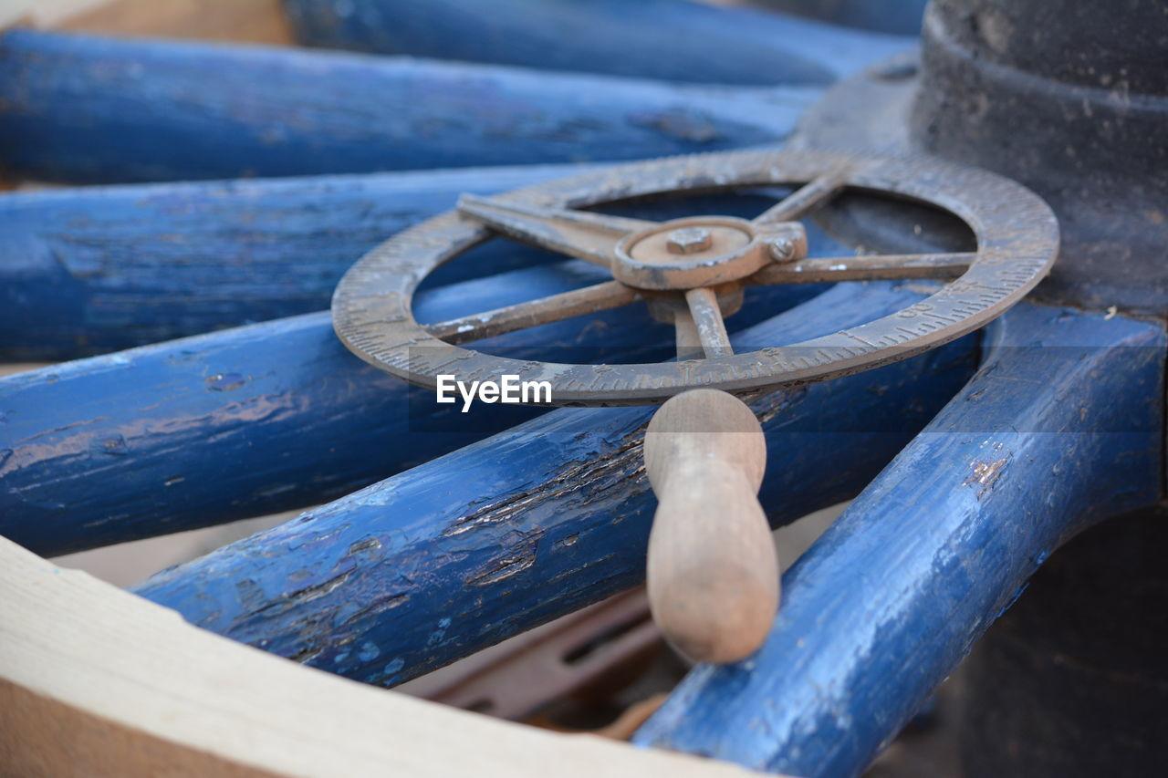 Close-Up Of Old Metallic Equipment On Wagon Wheel