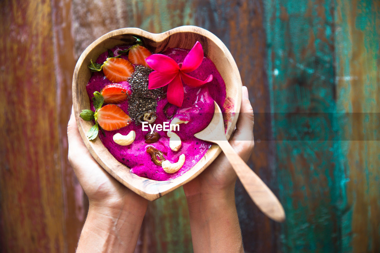 human hand, food and drink, freshness, holding, one person, human body part, food, real people, lifestyles, outdoors, close-up, flower, healthy eating, sweet food, multi colored, day, ready-to-eat, nature, people