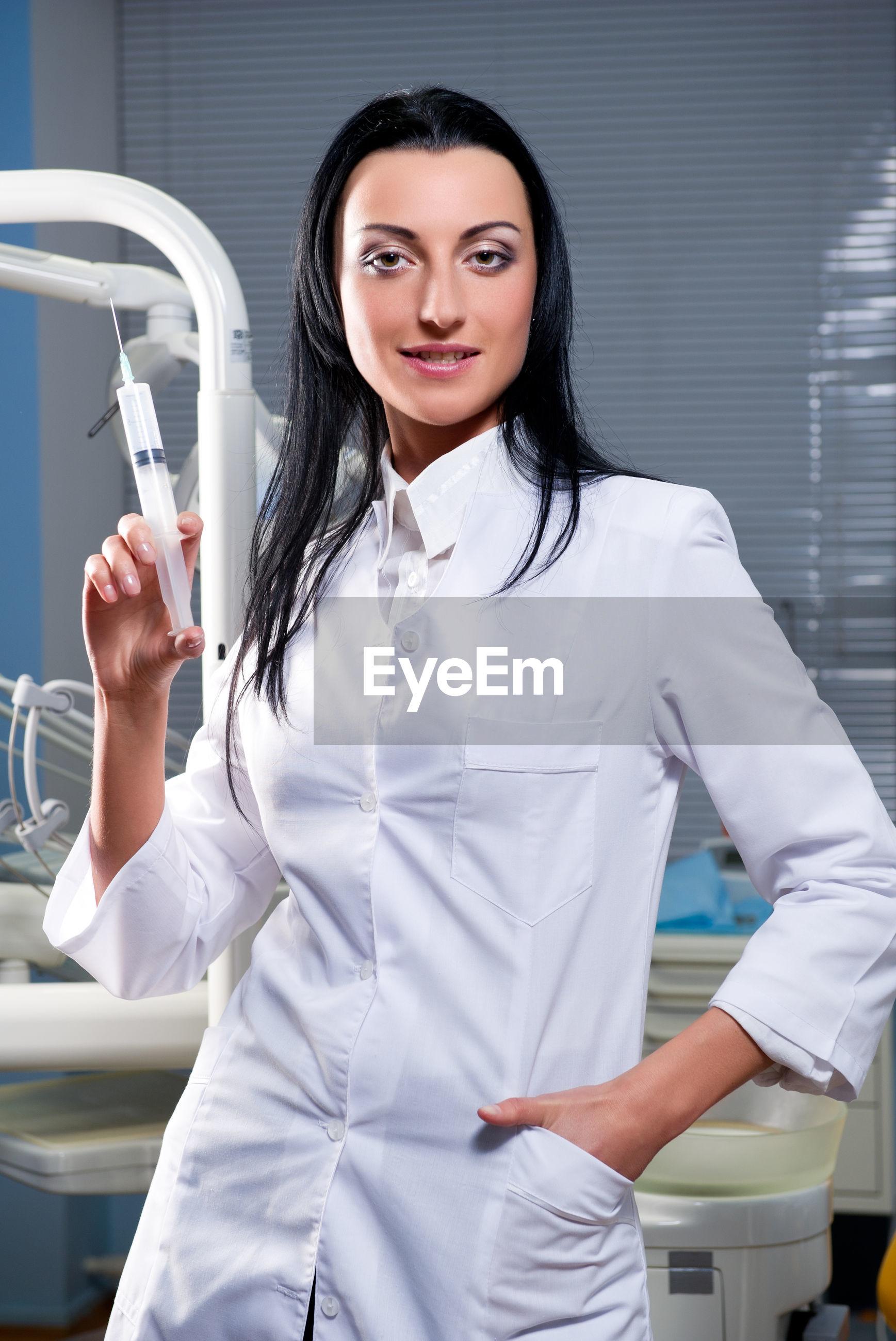 Portrait of nurse standing at hospital