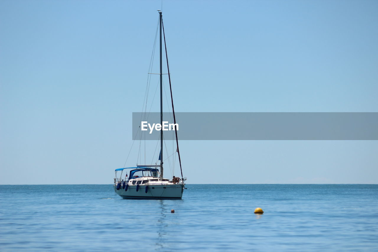 sea, water, sky, transportation, nautical vessel, horizon over water, sailboat, horizon, mode of transportation, waterfront, clear sky, blue, beauty in nature, copy space, scenics - nature, sailing, day, nature, mast, no people, luxury, yacht