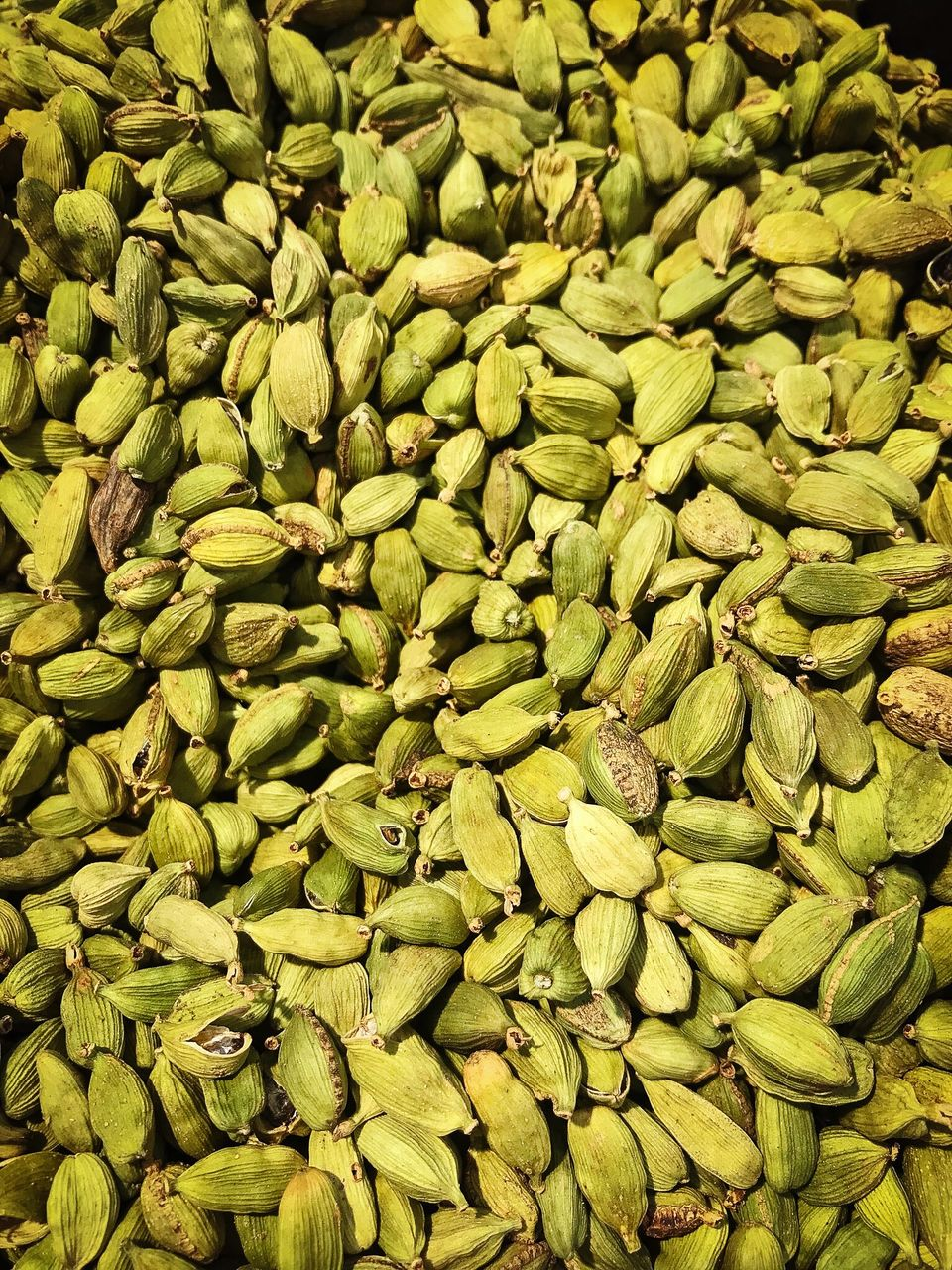 full frame, backgrounds, food and drink, abundance, green color, food, healthy eating, large group of objects, freshness, no people, wellbeing, still life, market, for sale, close-up, retail, high angle view, day, textured, heap, consumerism, cardamom