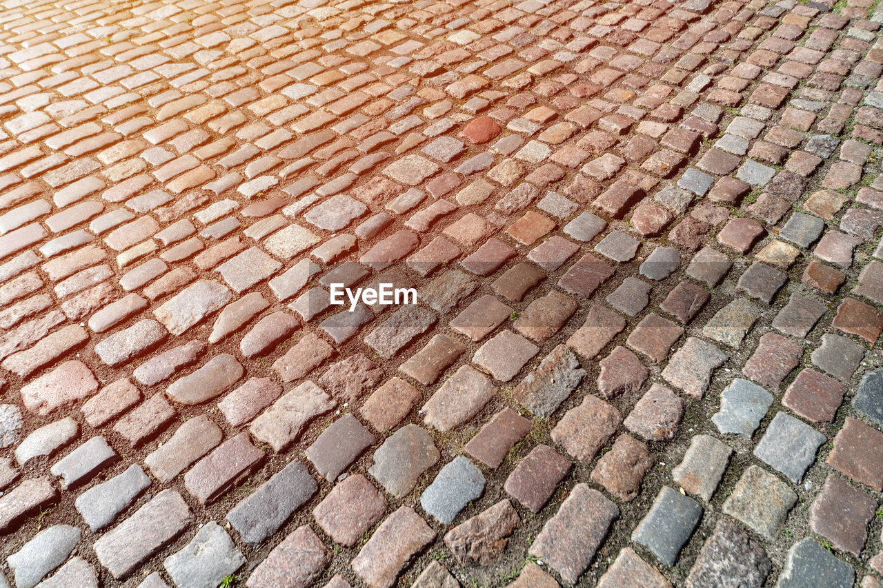 backgrounds, full frame, pattern, high angle view, no people, brick, day, footpath, cobblestone, textured, design, street, architecture, paving stone, repetition, close-up, brick wall, outdoors, shape, stone, roof tile