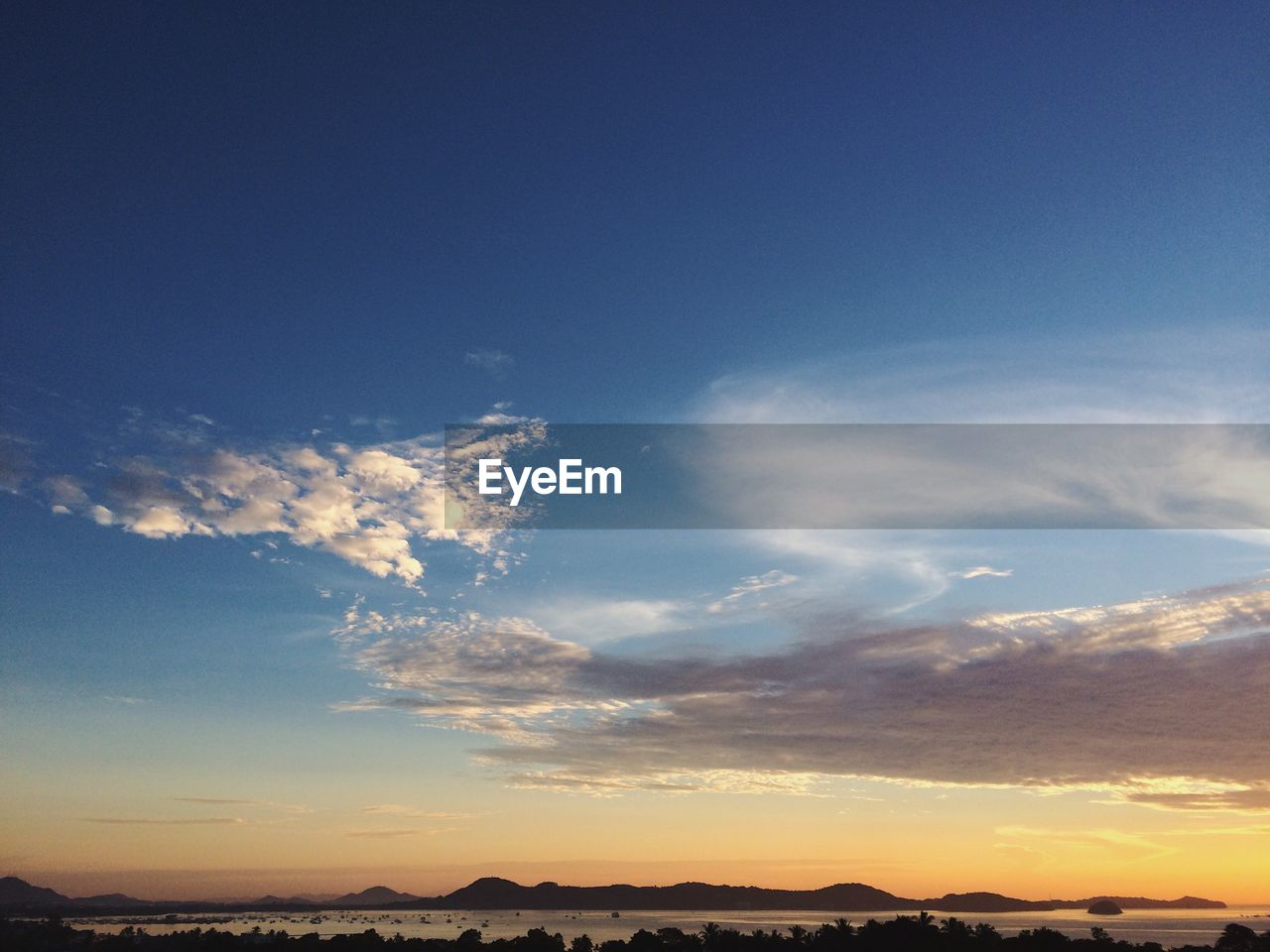 sky, tranquil scene, nature, blue, beauty in nature, sunset, tranquility, scenics, cloud - sky, no people, outdoors, day