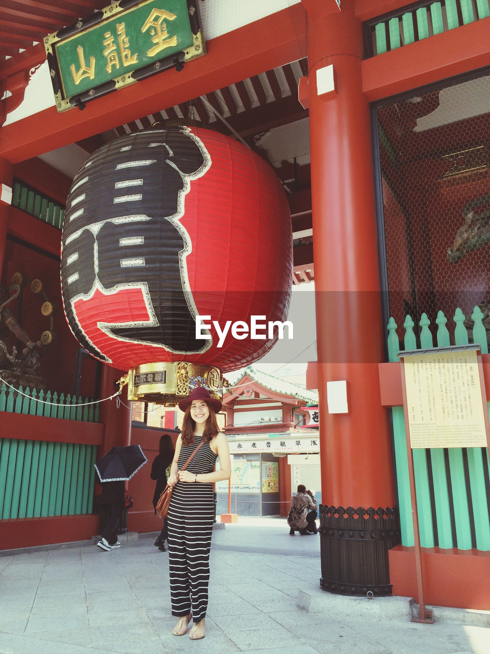 built structure, architecture, red, text, building exterior, communication, lantern, non-western script, hanging, outdoors, incidental people, cultures, tradition, arts culture and entertainment, culture, western script, travel, day, travel destinations