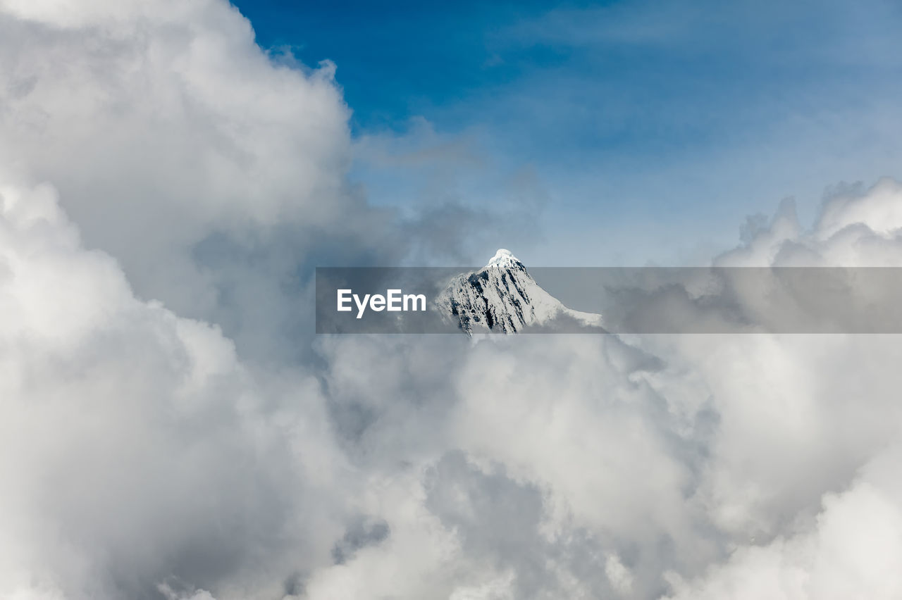 cloud - sky, sky, low angle view, nature, scenics, beauty in nature, outdoors, day, flying, no people, tranquility, mountain, sky only, spread wings