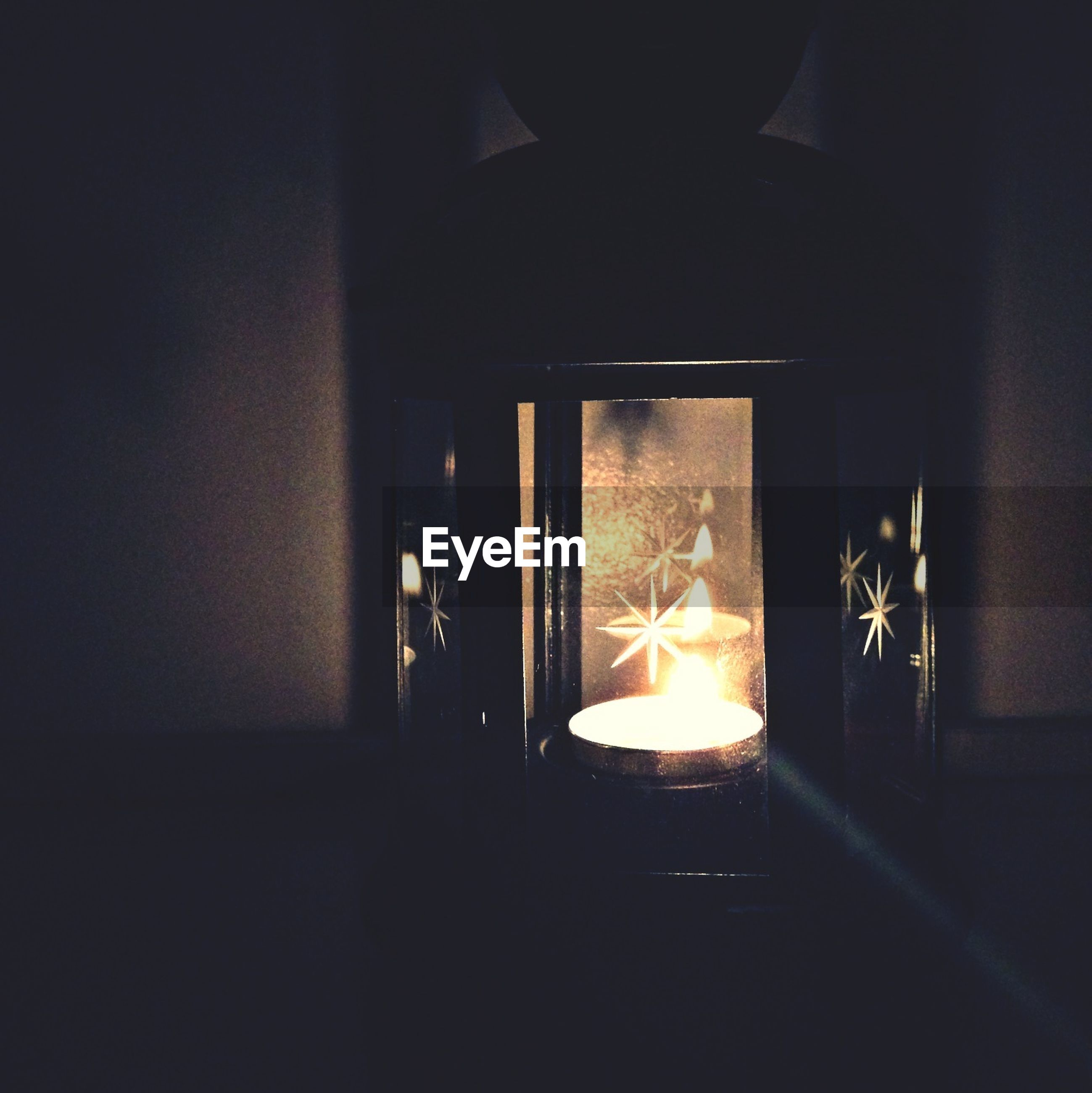 indoors, illuminated, dark, night, glowing, darkroom, window, no people, light - natural phenomenon, wall - building feature, home interior, lighting equipment, house, close-up, copy space, built structure, glass - material, burning, room, fire - natural phenomenon