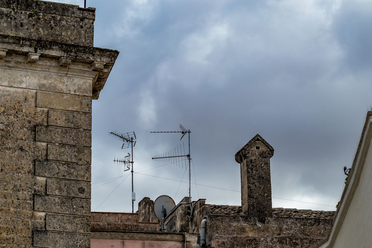 architecture, built structure, sky, cloud - sky, building exterior, nature, low angle view, antenna - aerial, building, technology, communication, day, connection, television aerial, no people, satellite, telecommunications equipment, outdoors, satellite dish, roof