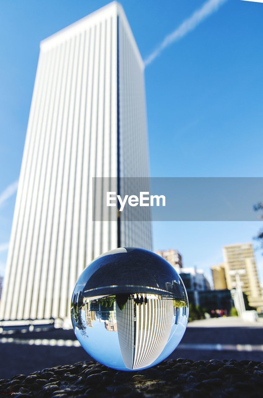 architecture, built structure, building exterior, outdoors, blue, skyscraper, modern, day, clear sky, city, no people, close-up, sky