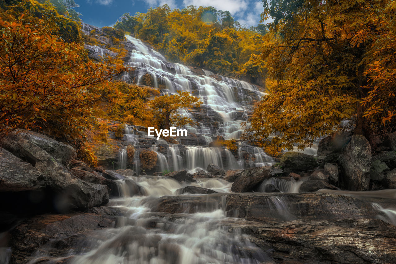 waterfall, motion, long exposure, nature, flowing water, water, tree, scenics, beauty in nature, autumn, rock - object, no people, outdoors, river, forest, day, rapid, mountain, power in nature, sky, freshness