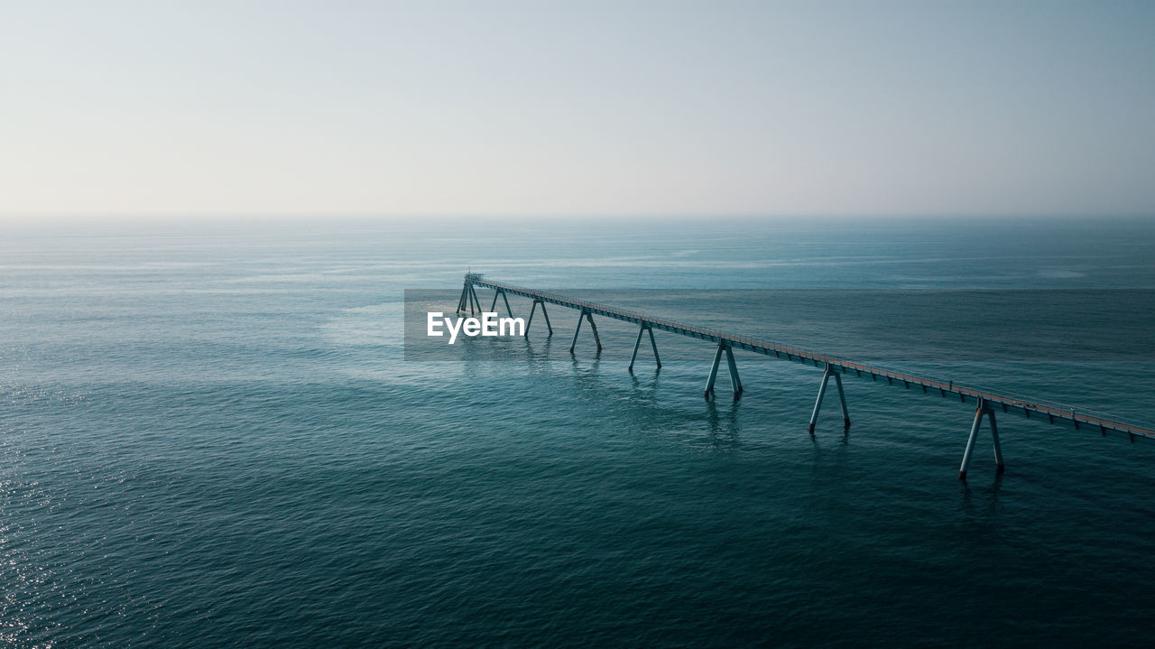 sea, sky, water, scenics - nature, beauty in nature, horizon over water, horizon, tranquility, tranquil scene, waterfront, nature, idyllic, clear sky, no people, copy space, pier, railing, non-urban scene, outdoors